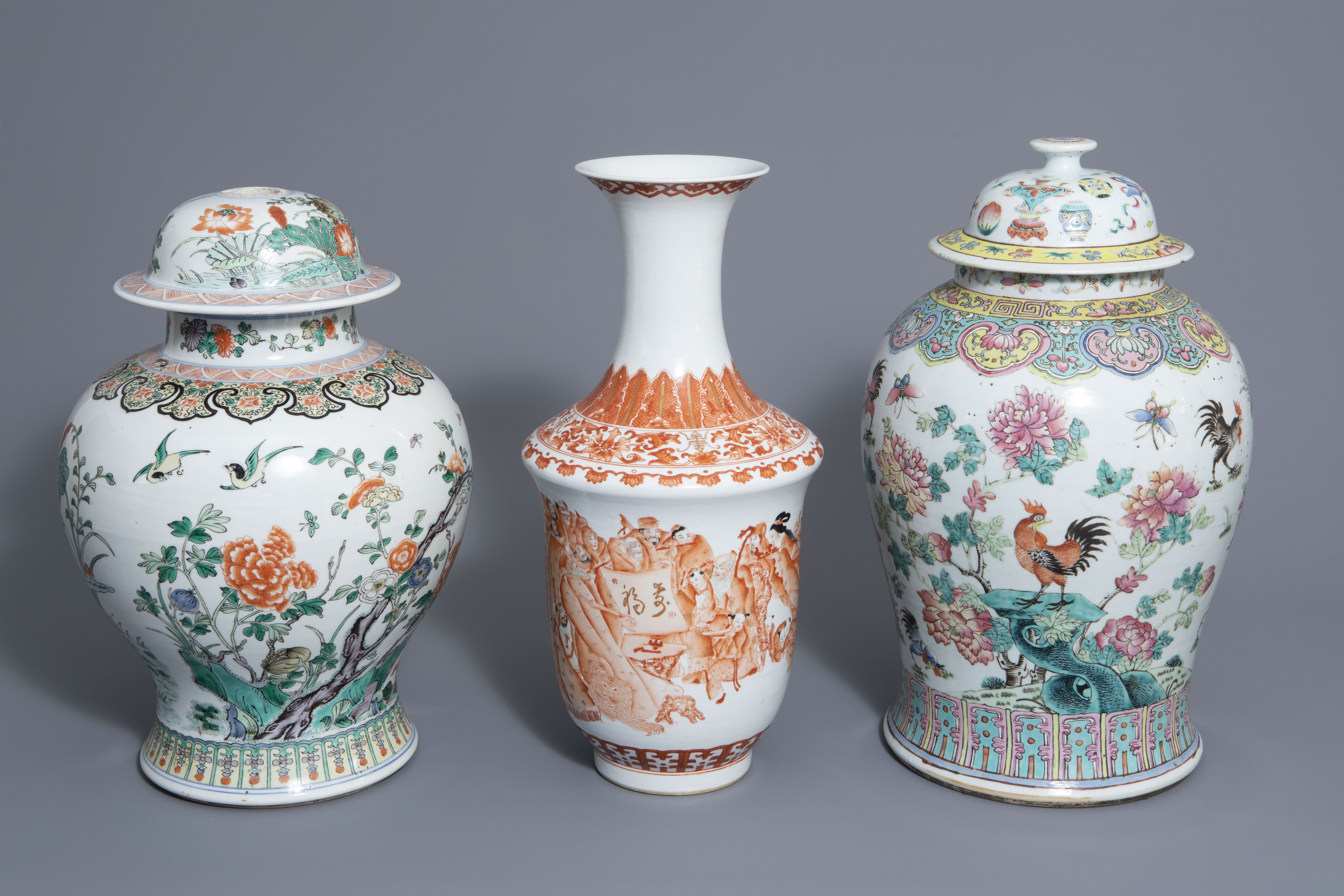 Three Chinese famille rose, verte and iron red vases with different designs, 19th/20th C.
