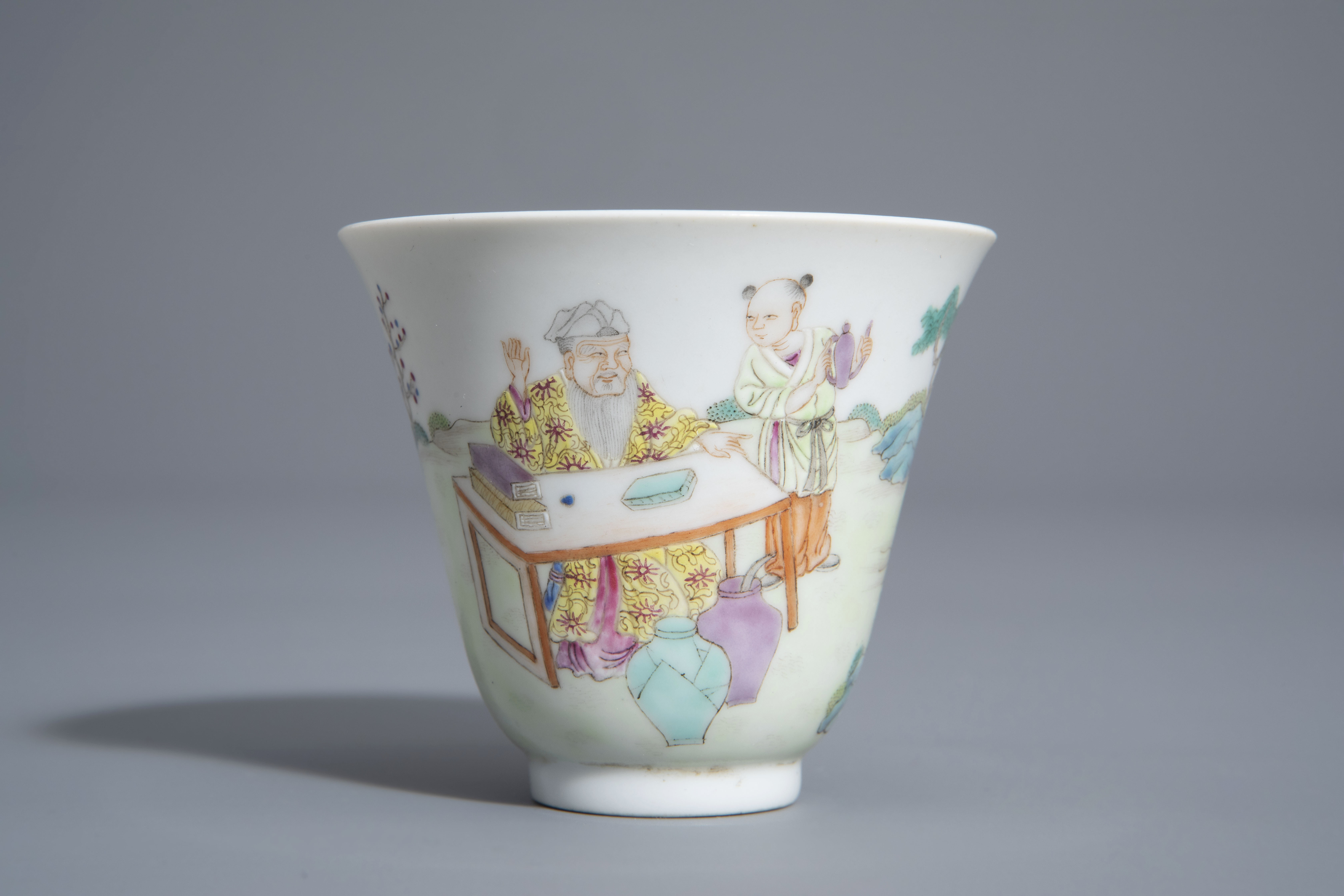 A Chinese famille rose cup and a saucer with different designs, 19th/20th C. - Image 5 of 11