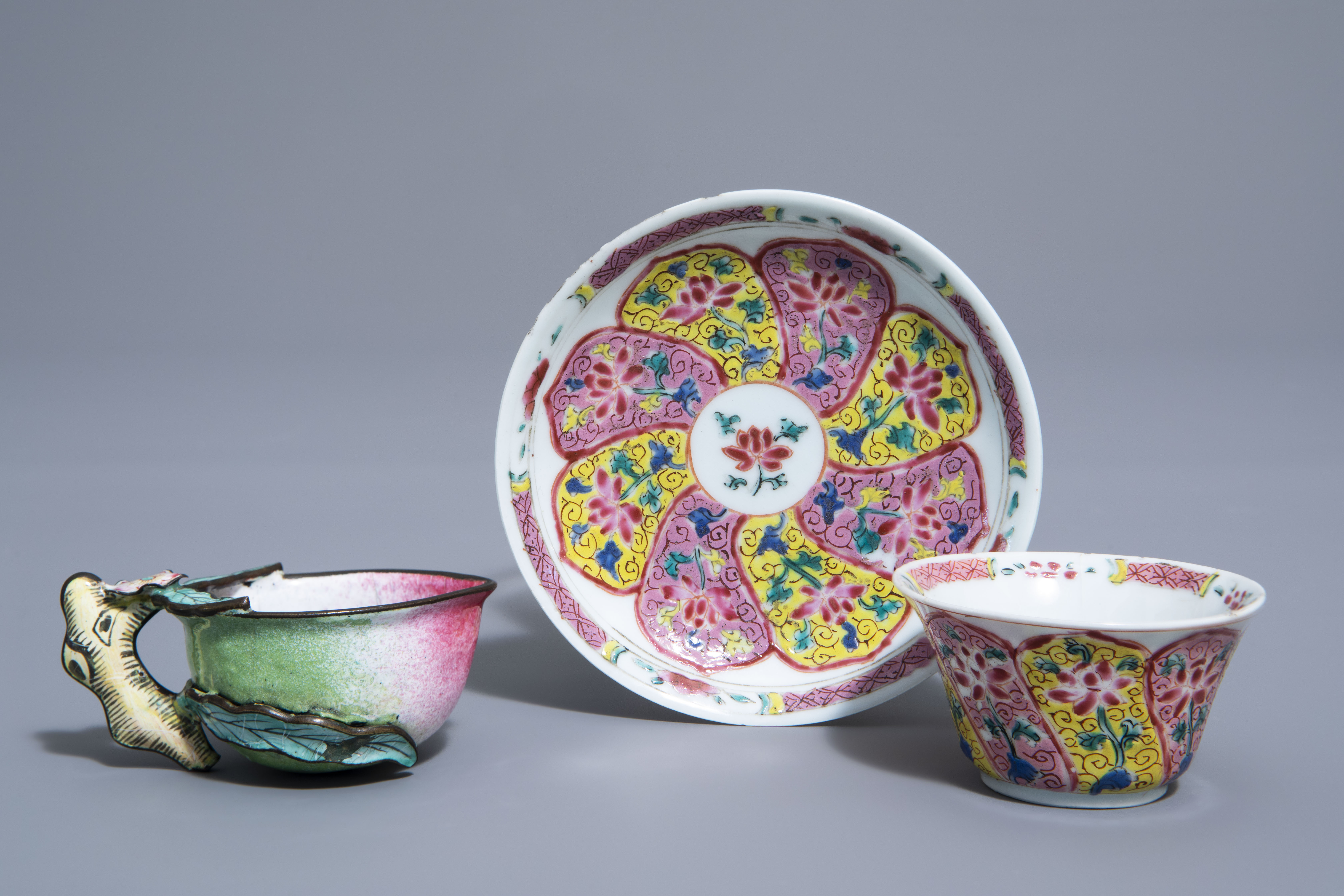 A Chinese famille rose cup and saucer and a Canton enamel peach shaped cup, Yongzheng/Qianlong