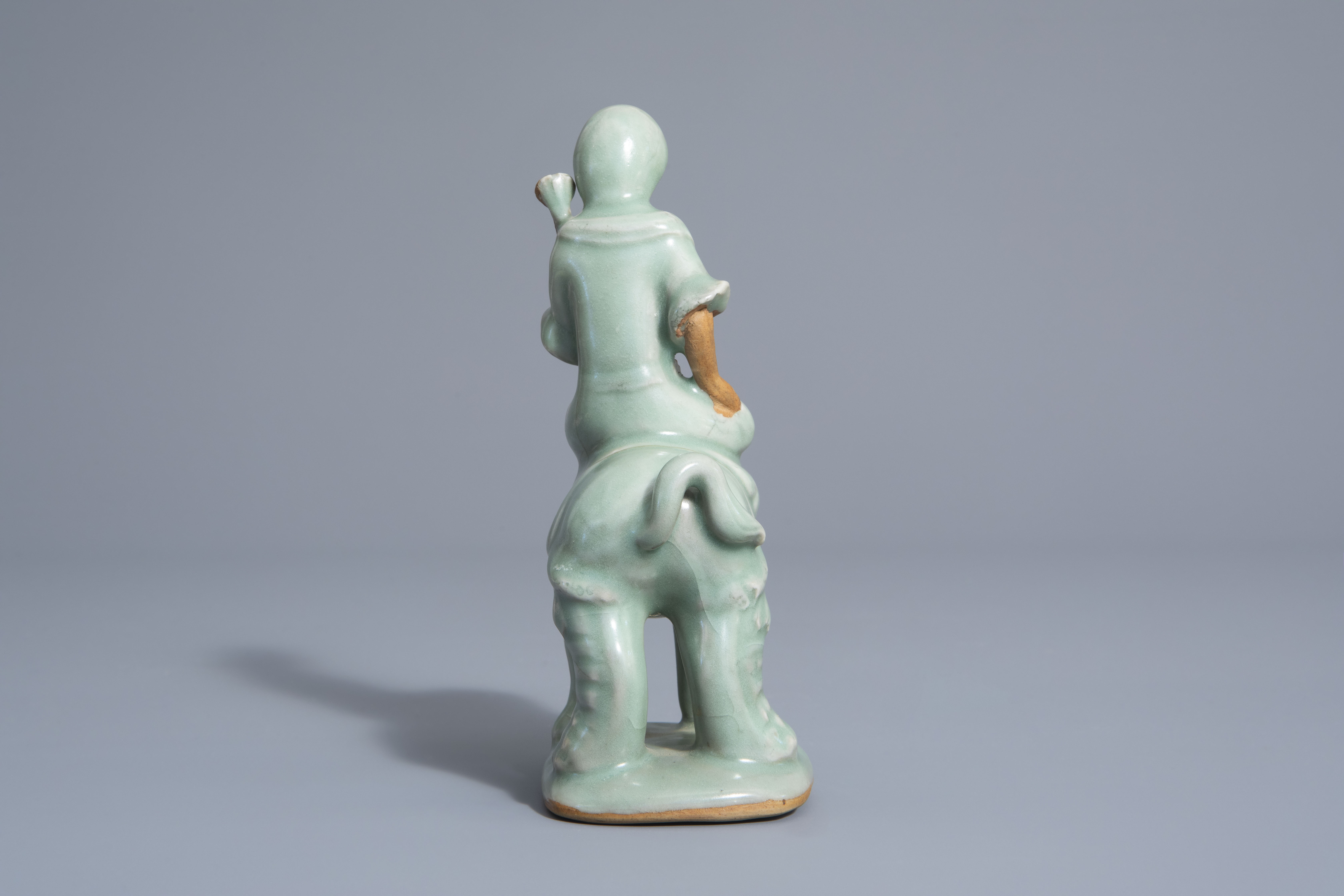 A Chinese celadon glazed group, 19th/20th C. - Image 3 of 7