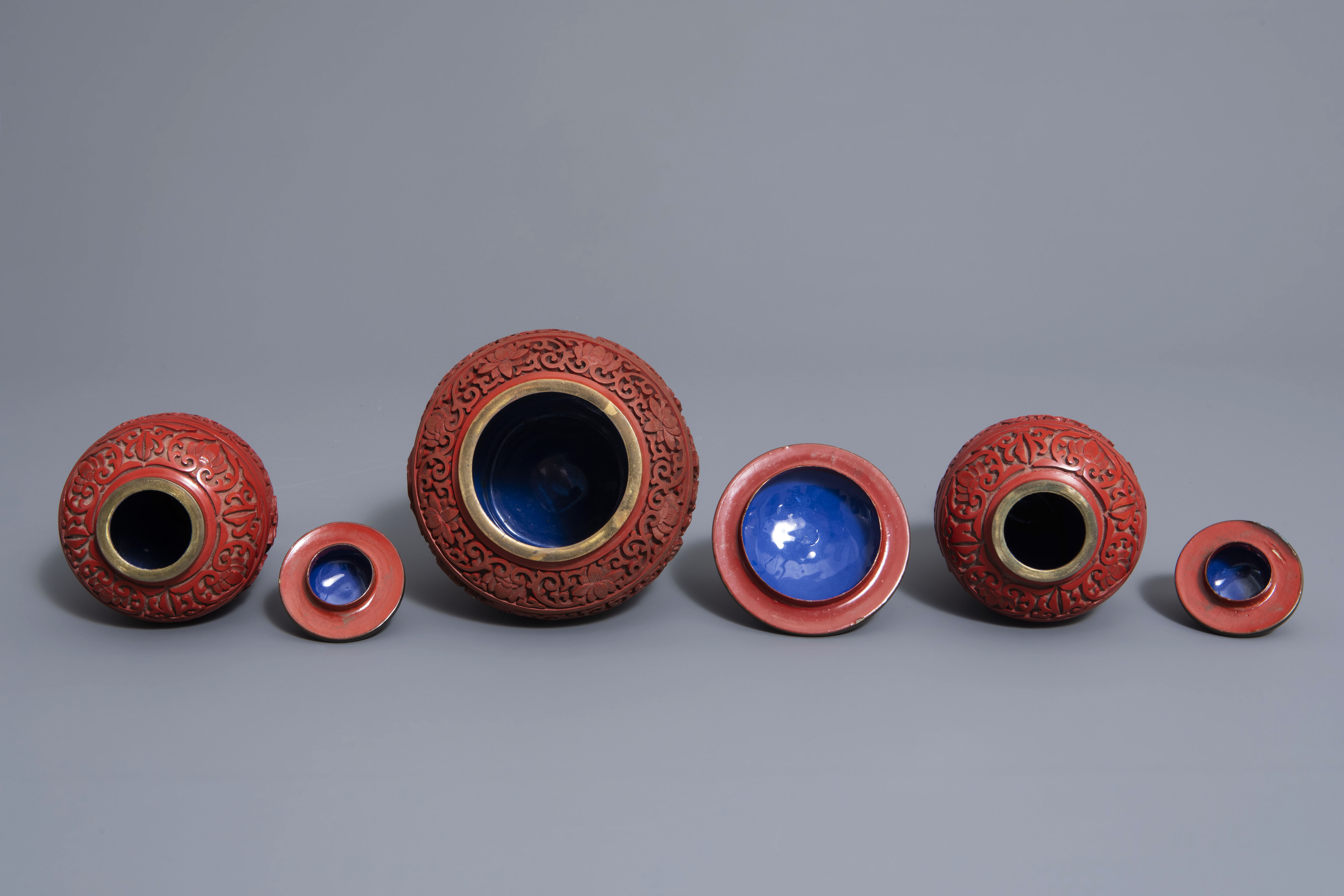 A Chinese tea block, cloisonné teapot, wall vase, bamboo brush pot & 3 red lacquer vases, 20th C. - Image 6 of 16
