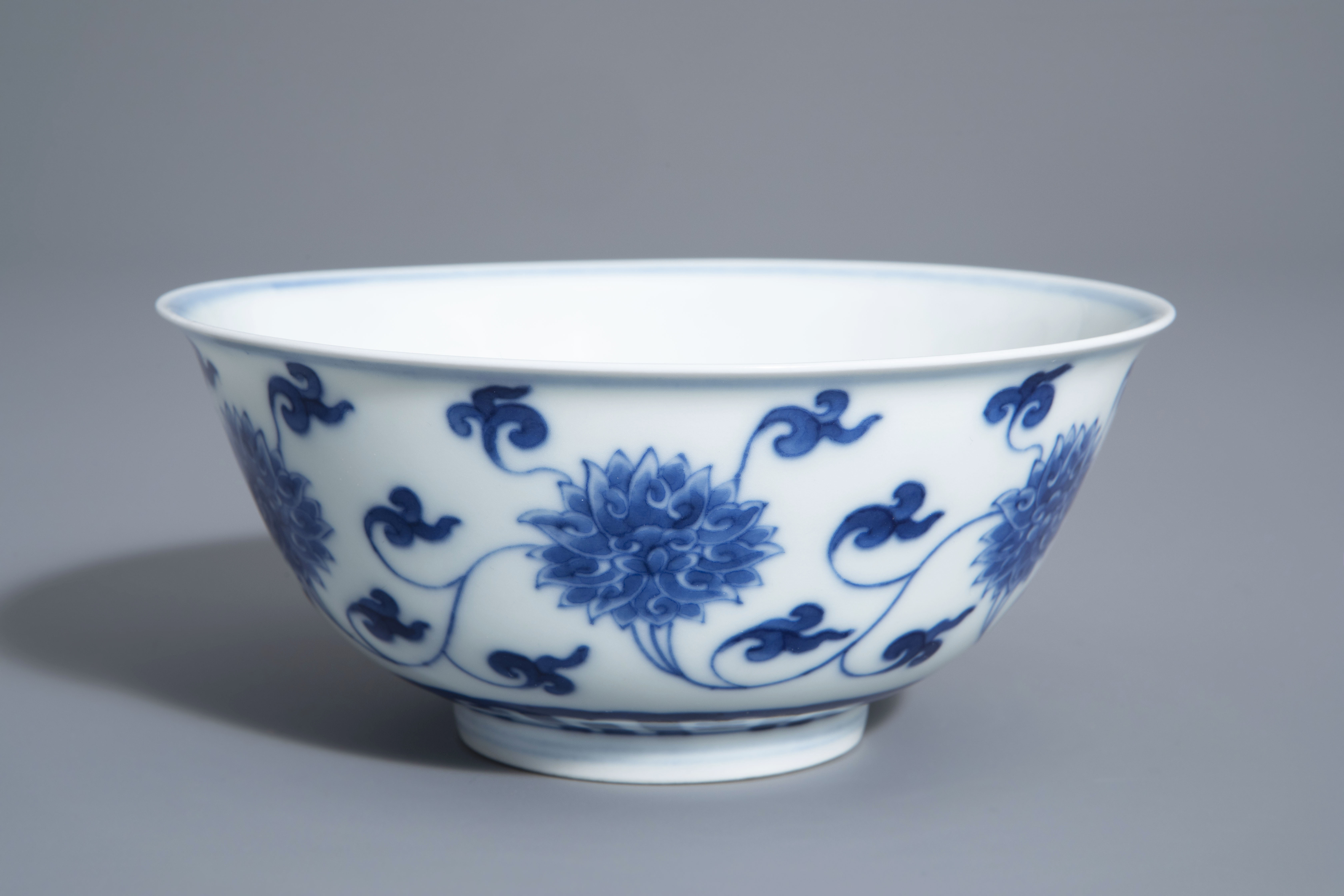 A Chinese blue and white 'lotus scroll' bowl, Kangxi mark, 19th/20th C.