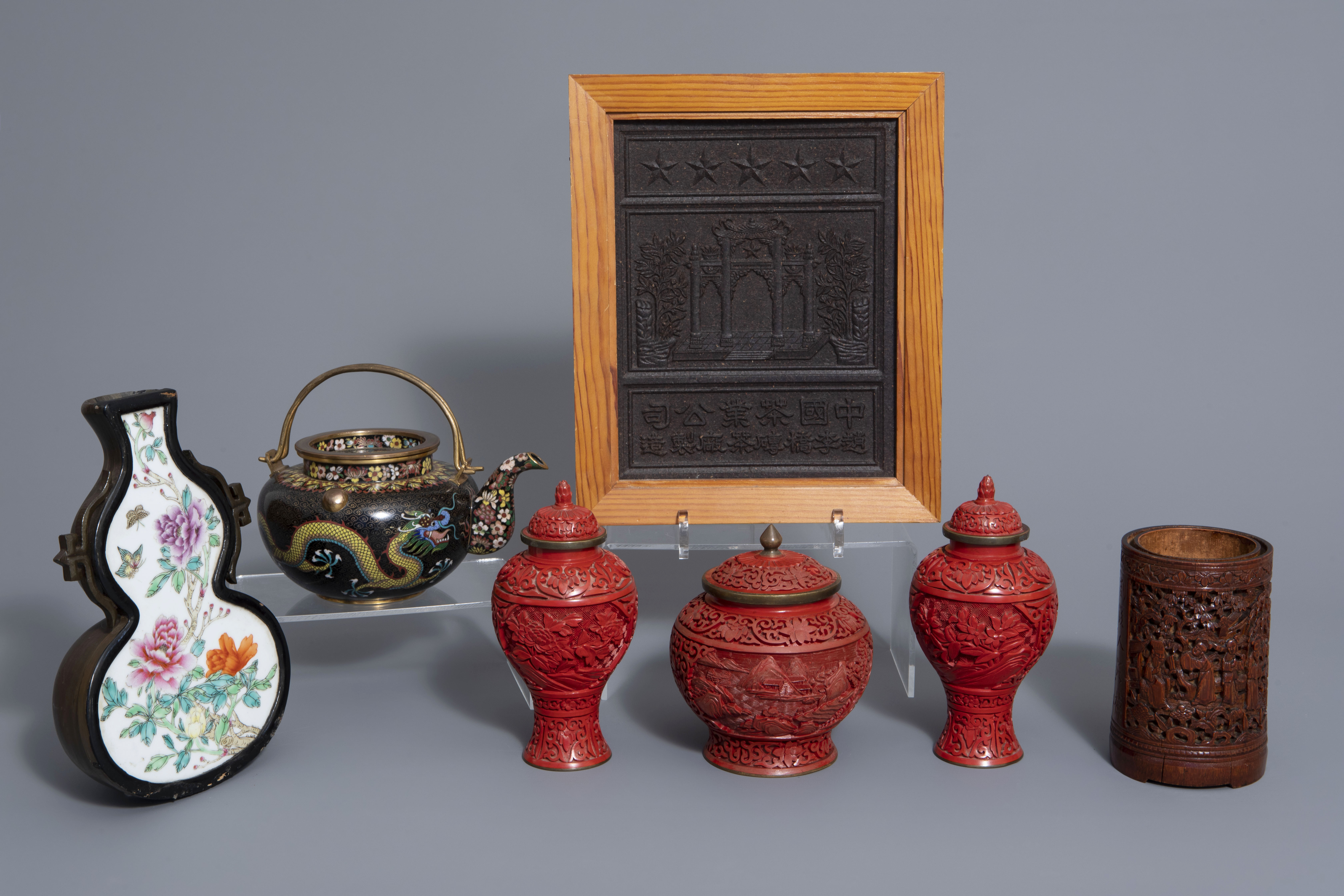 A Chinese tea block, cloisonné teapot, wall vase, bamboo brush pot & 3 red lacquer vases, 20th C.