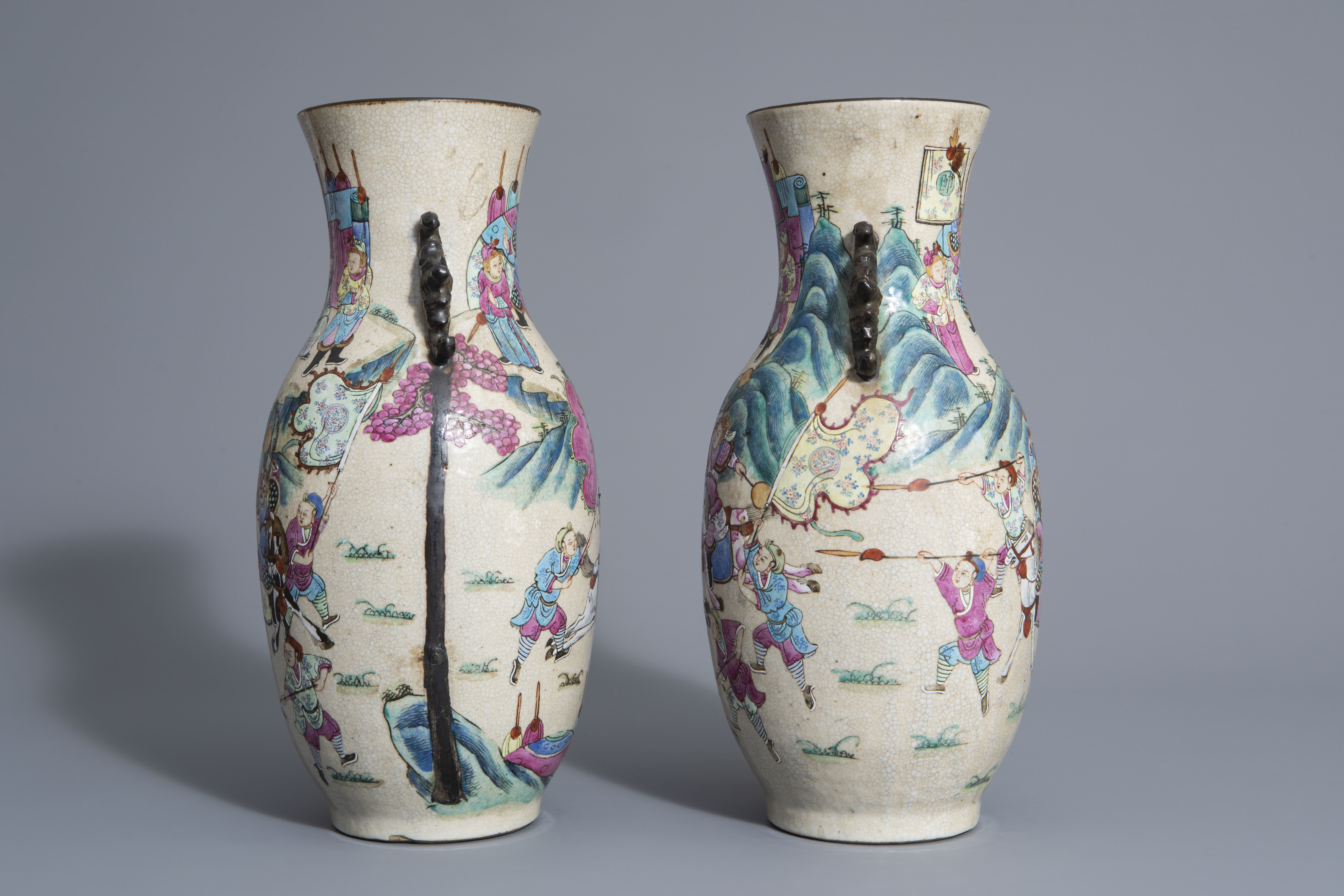 A pair of Chinese Nanking crackle glazed famille rose vases w. warrior scenes on stands, 19th C. - Image 5 of 7