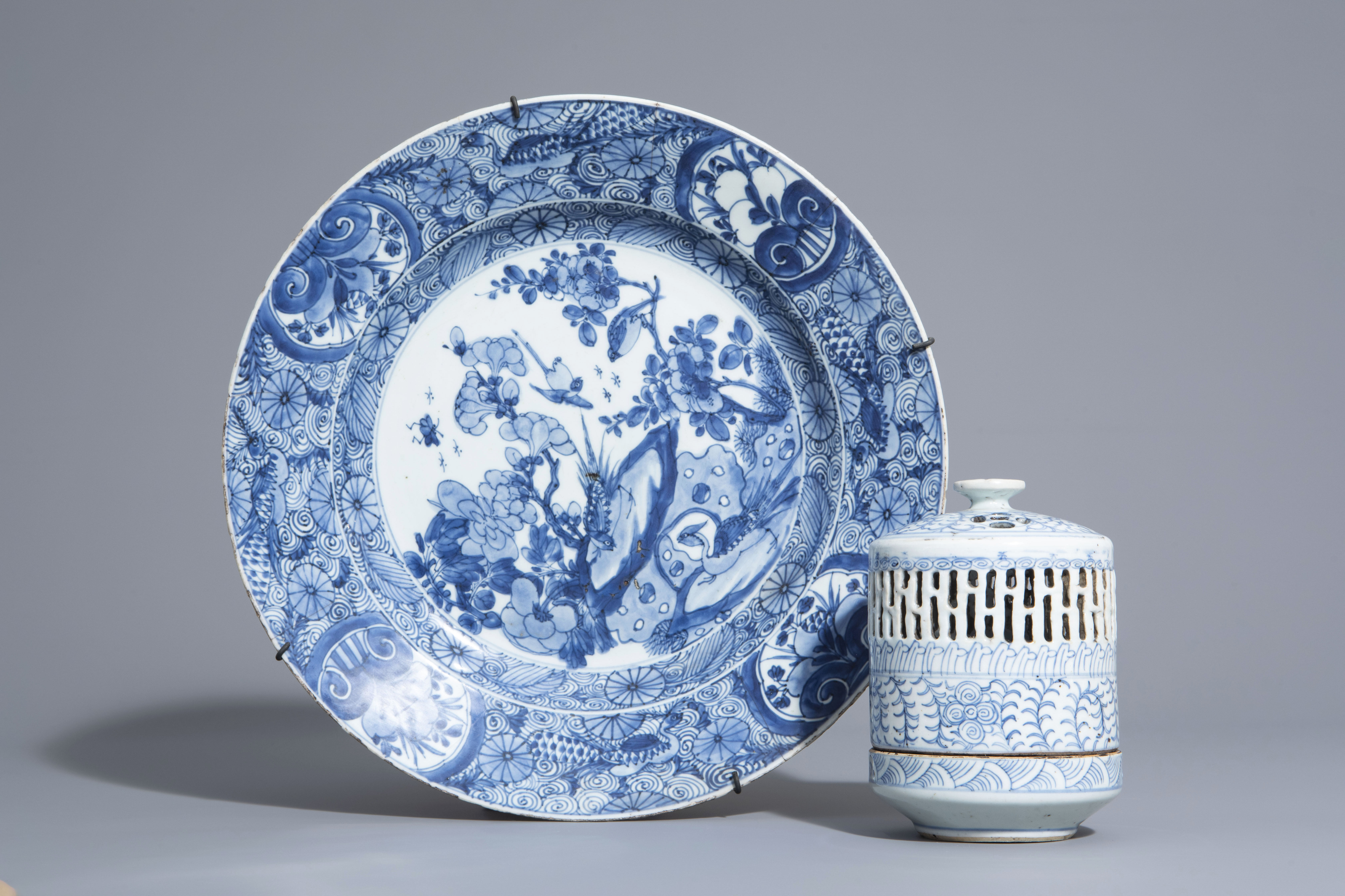 A Chinese blue and white charger and a Peranakan or Straits market night light, Kangxi and 19th C.