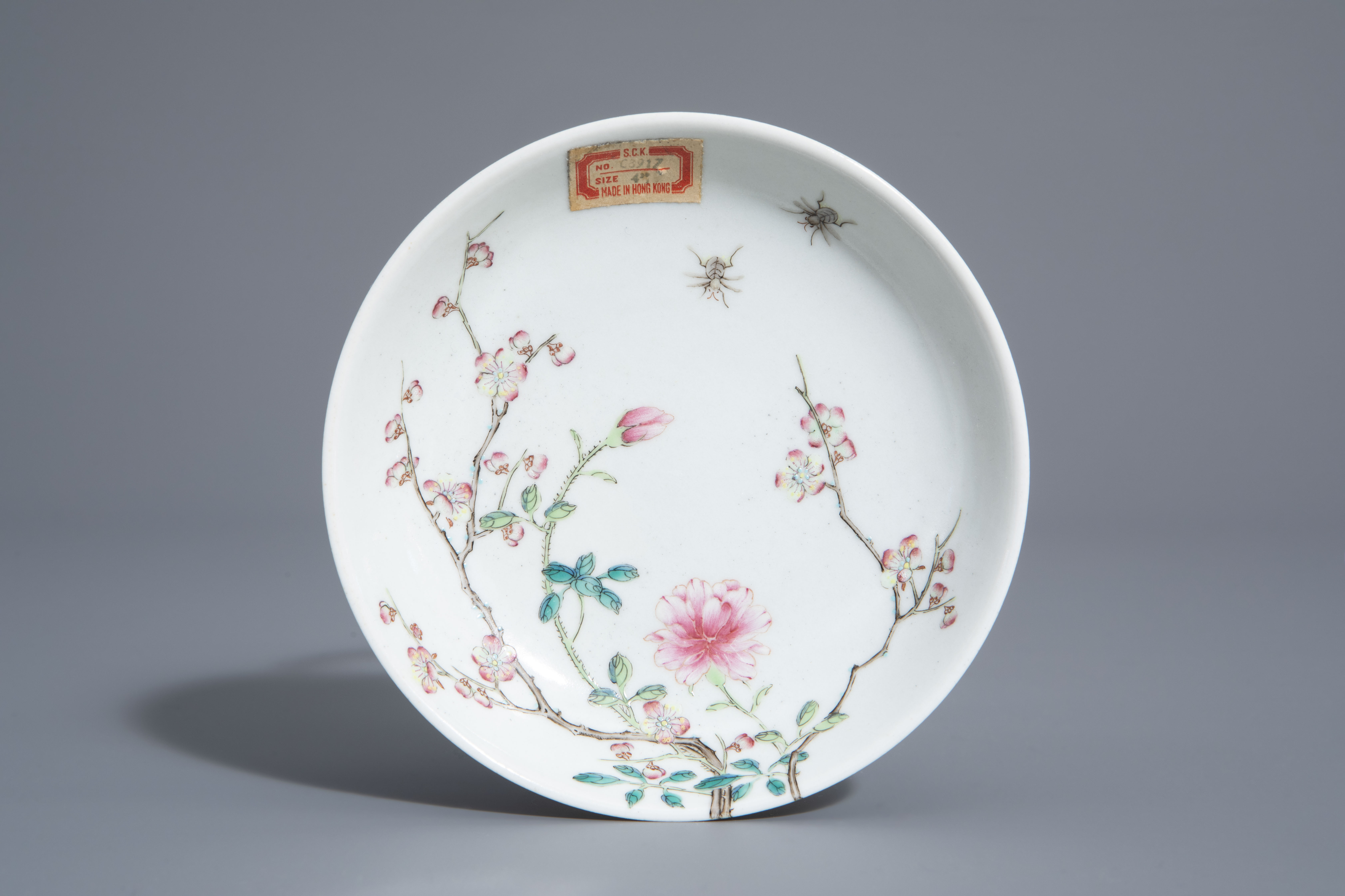 A Chinese famille rose cup and a saucer with different designs, 19th/20th C. - Image 2 of 11
