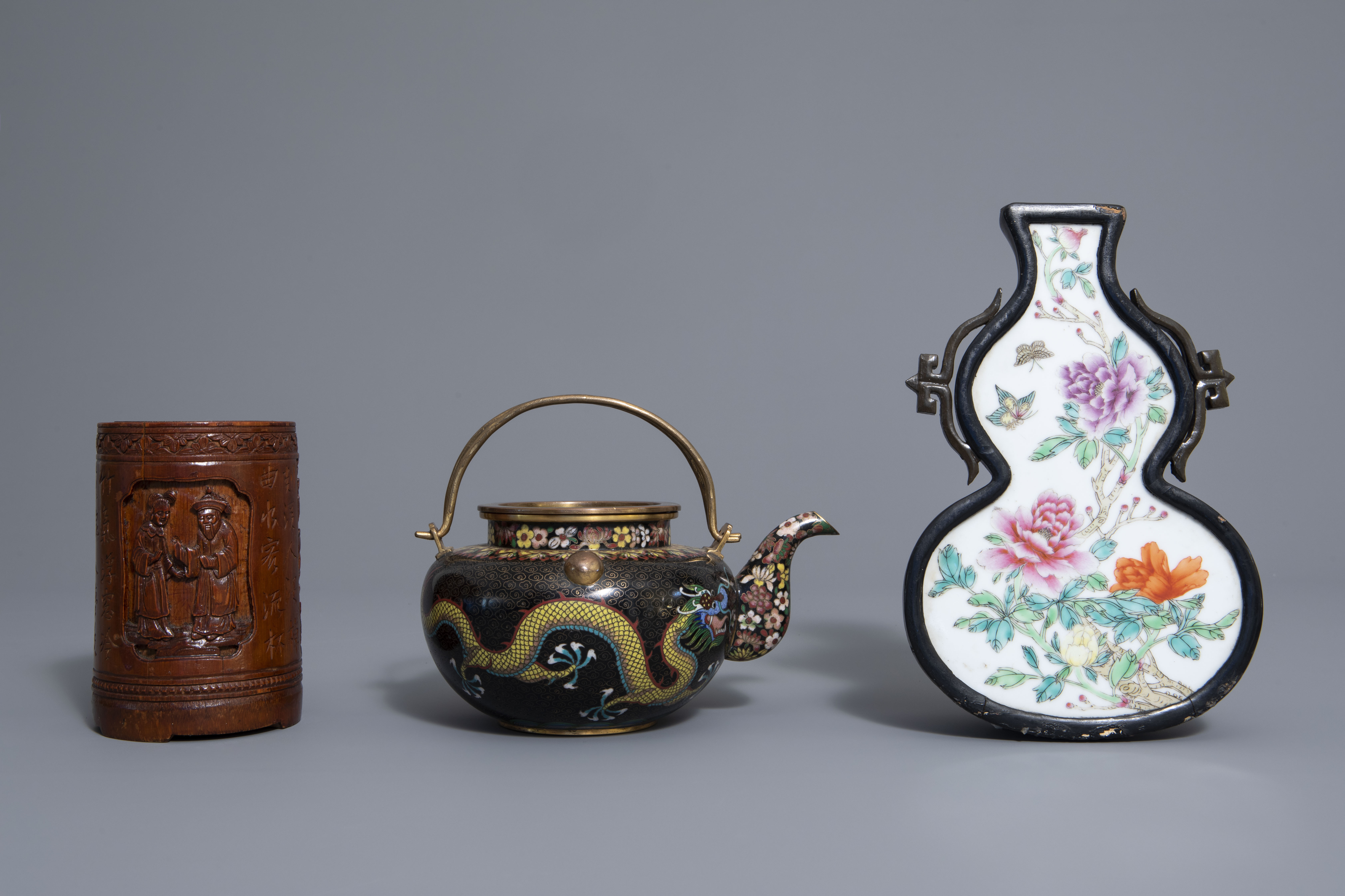 A Chinese tea block, cloisonné teapot, wall vase, bamboo brush pot & 3 red lacquer vases, 20th C. - Image 10 of 16