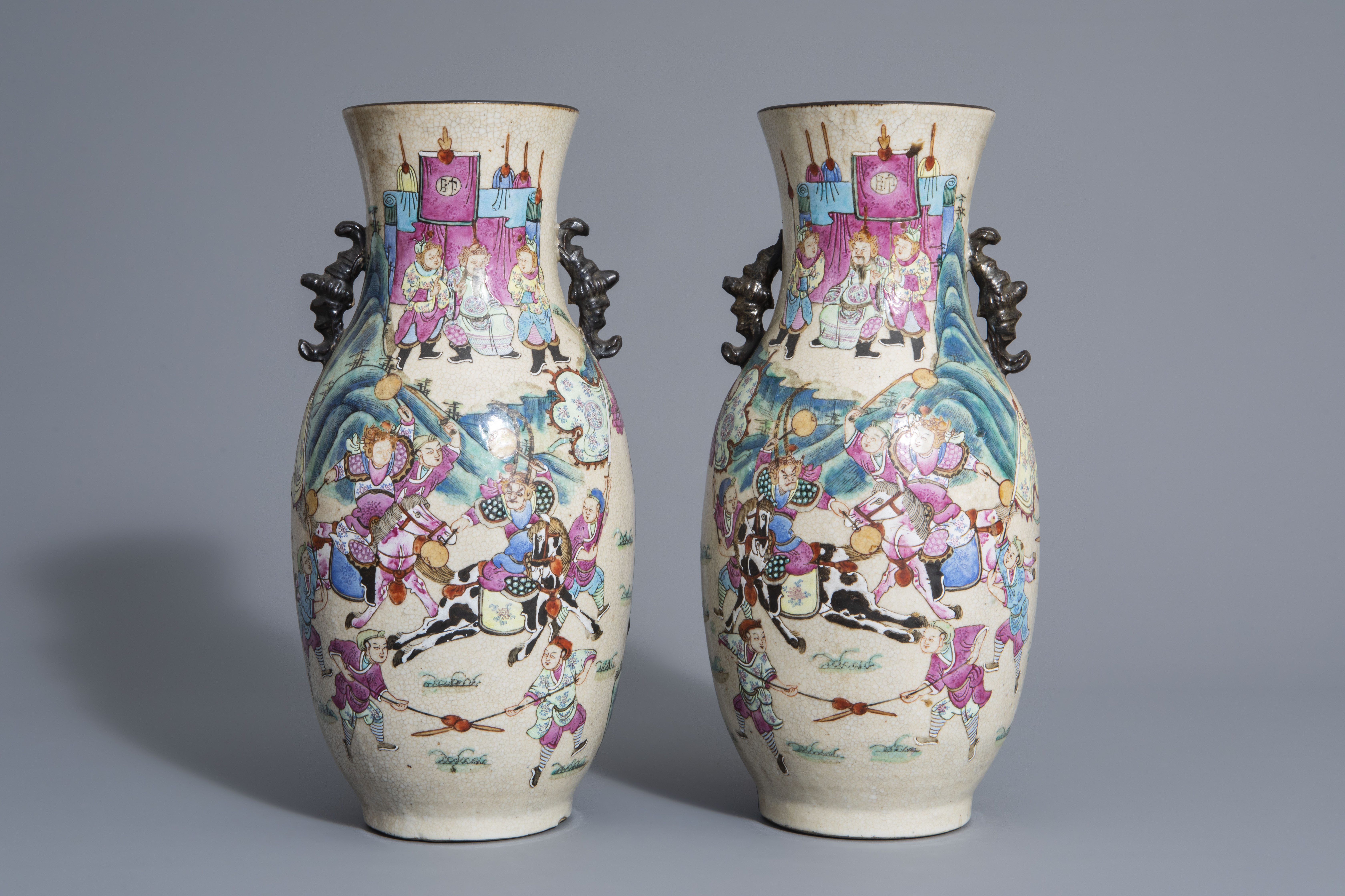 A pair of Chinese Nanking crackle glazed famille rose vases w. warrior scenes on stands, 19th C. - Image 2 of 7