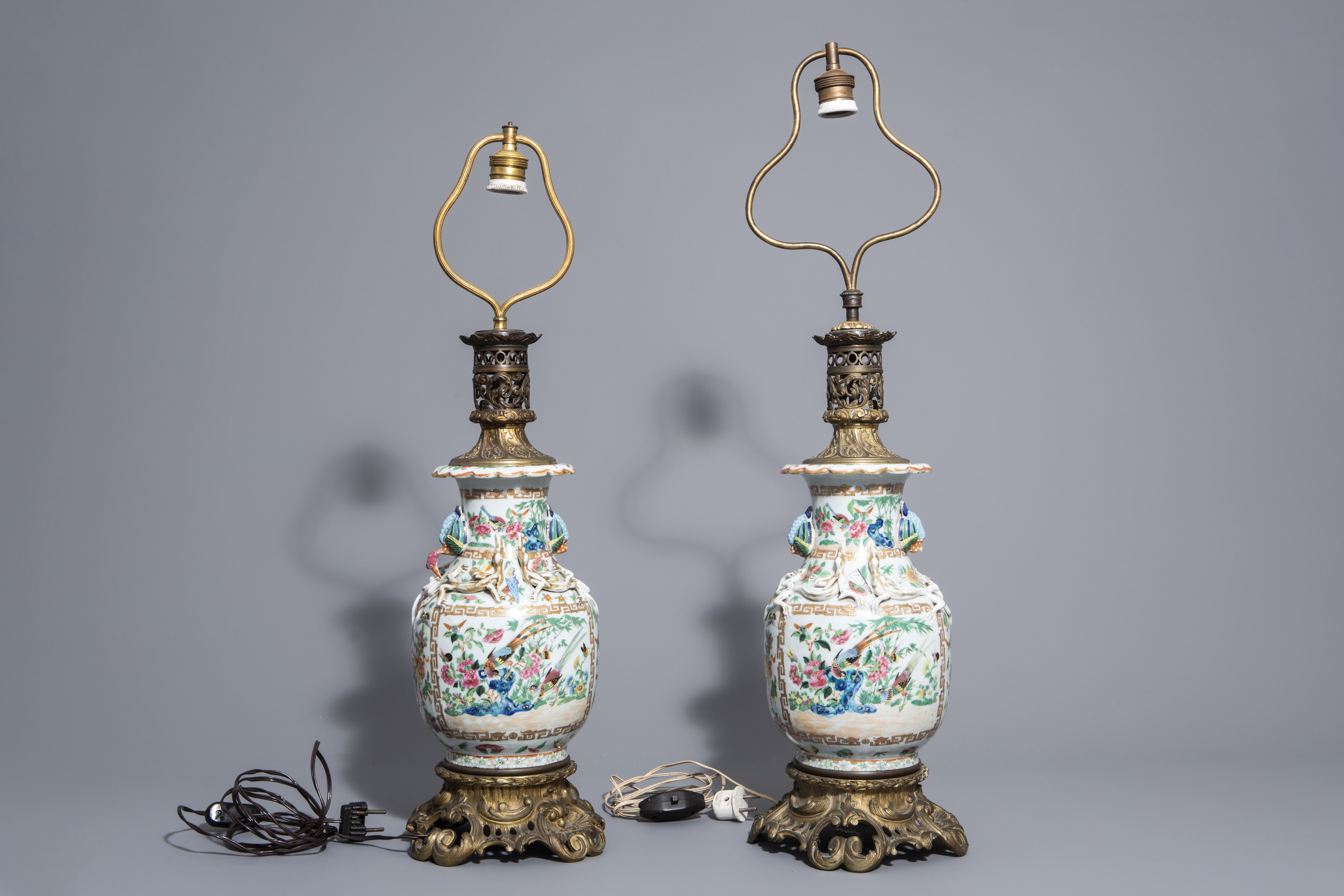 A pair of Chinese Canton famille rose vases mounted as lamps and a famille verte jar, 19th C. - Image 2 of 13