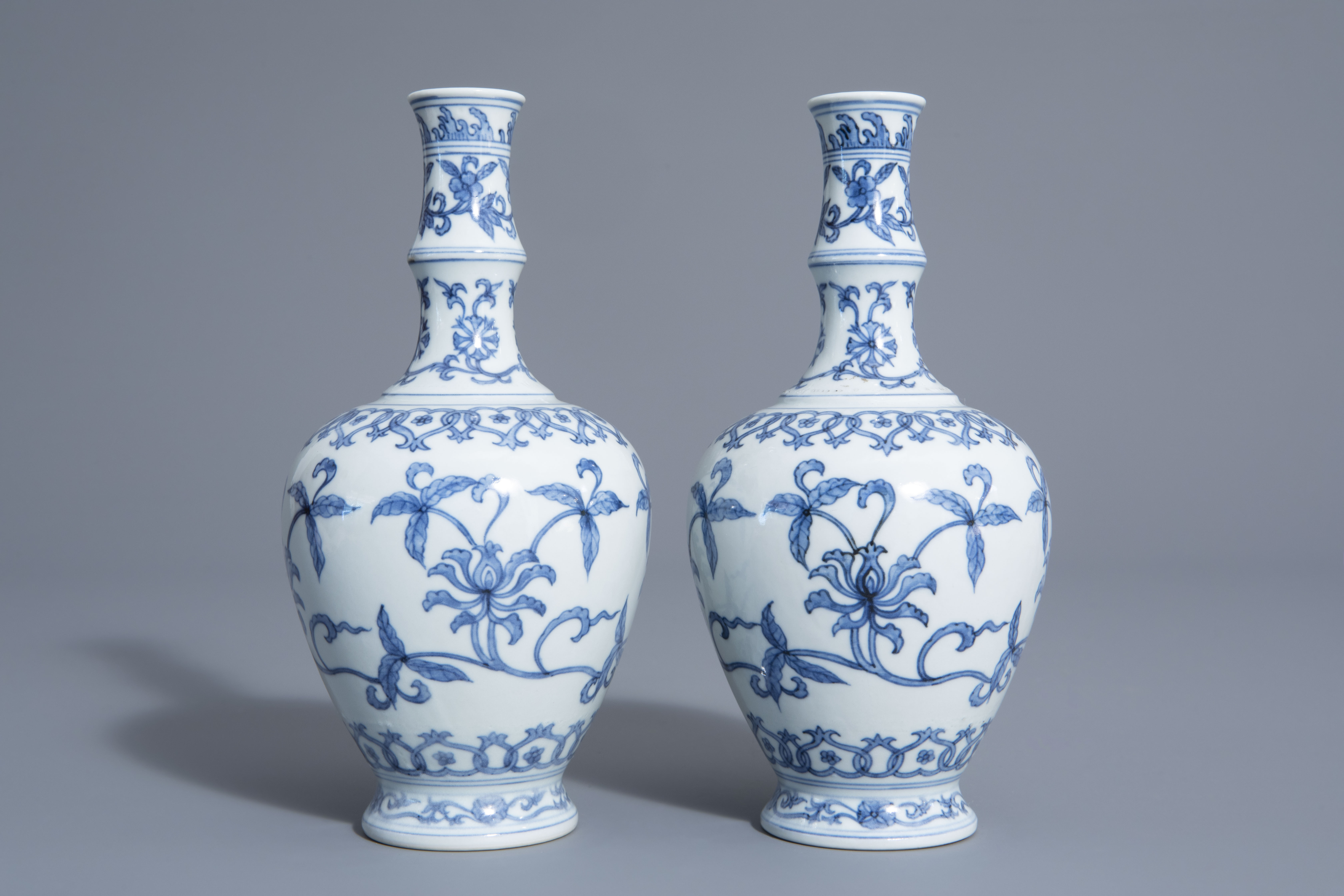 A pair of Chinese blue and white vases with floral design, Chenghua mark, 19th/20th C. - Image 3 of 6