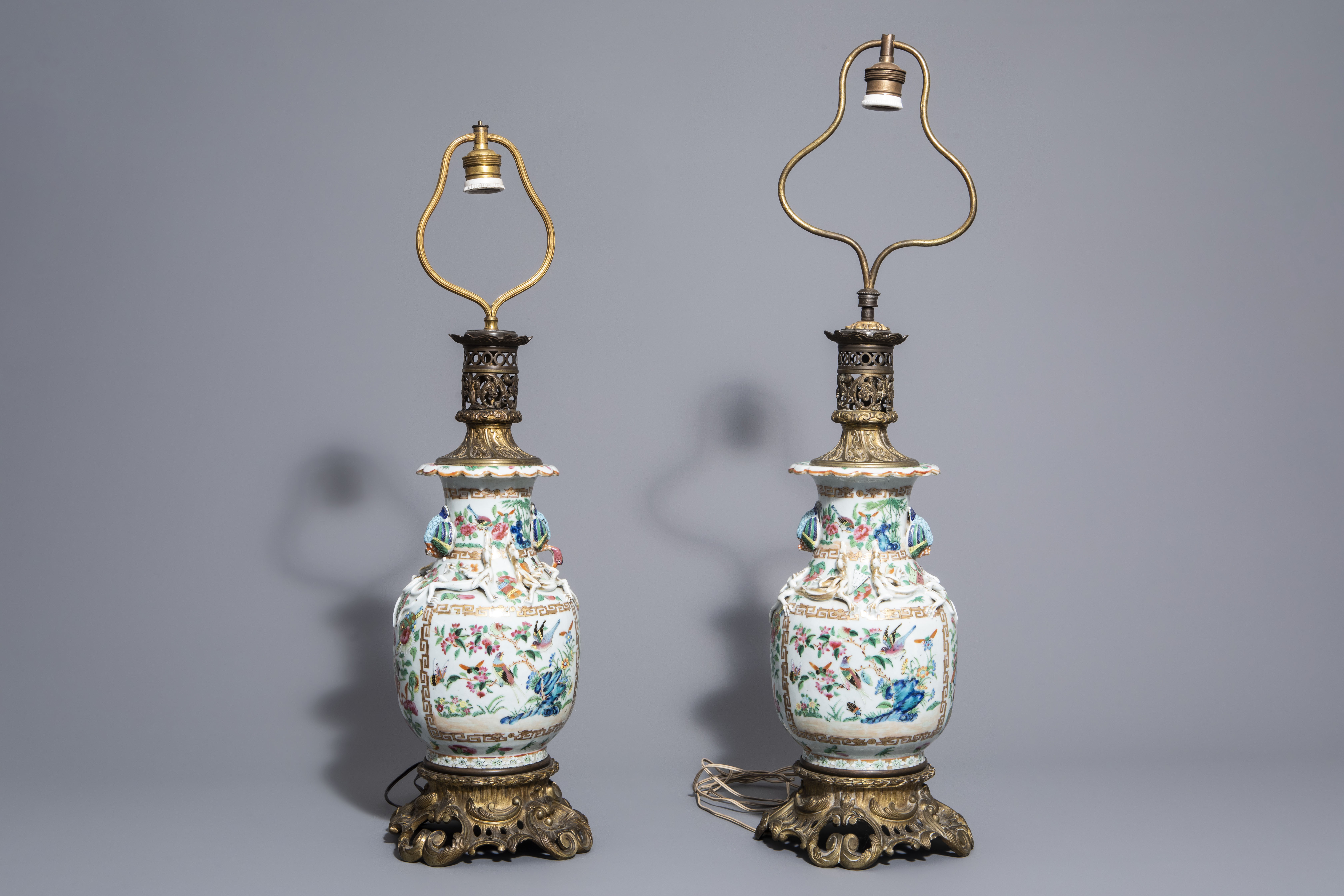 A pair of Chinese Canton famille rose vases mounted as lamps and a famille verte jar, 19th C. - Image 4 of 13