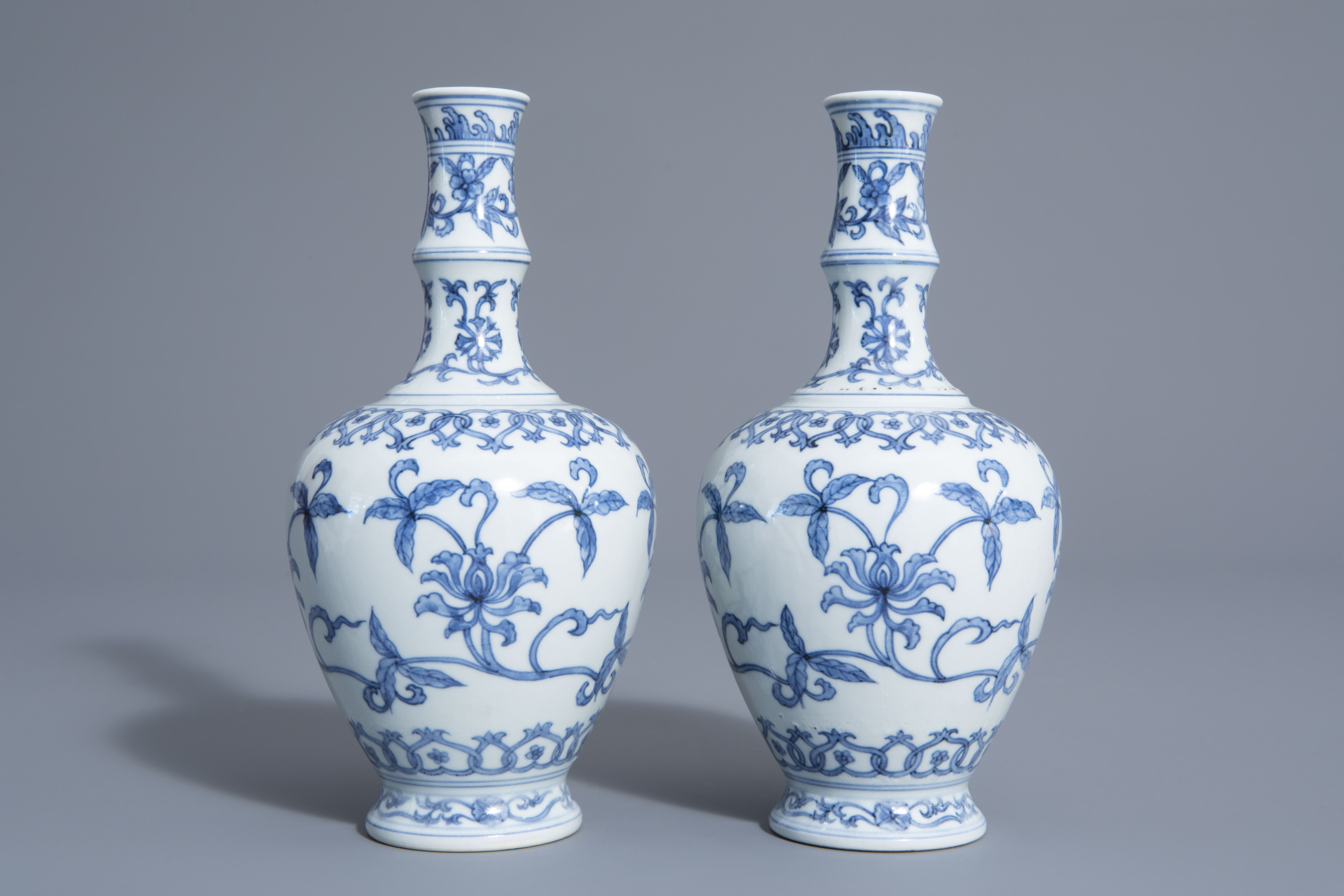 A pair of Chinese blue and white vases with floral design, Chenghua mark, 19th/20th C. - Image 2 of 6