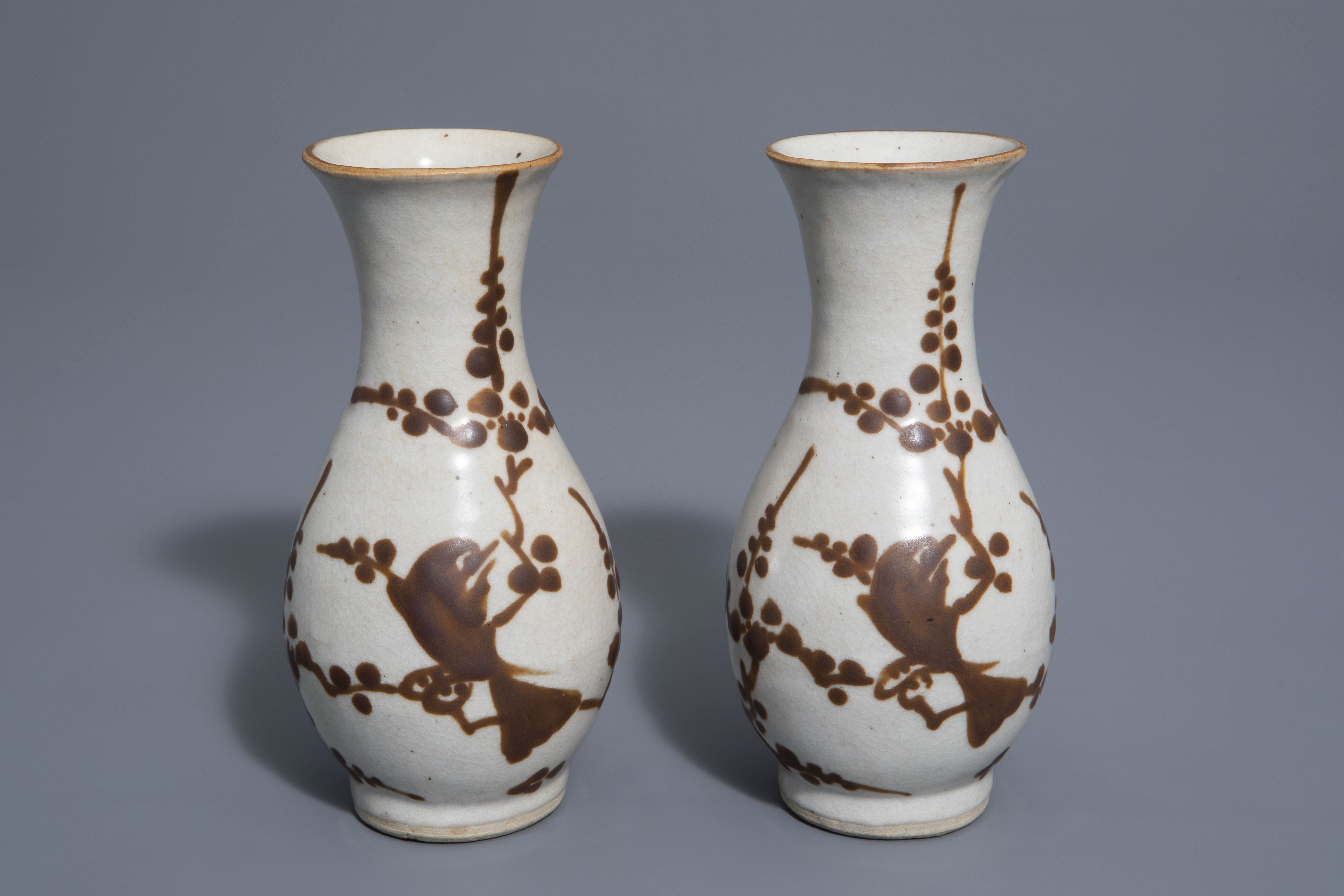 A pair of Chinese Cizhou style slip decorated vases with birds on blossoming branches, 19th C.