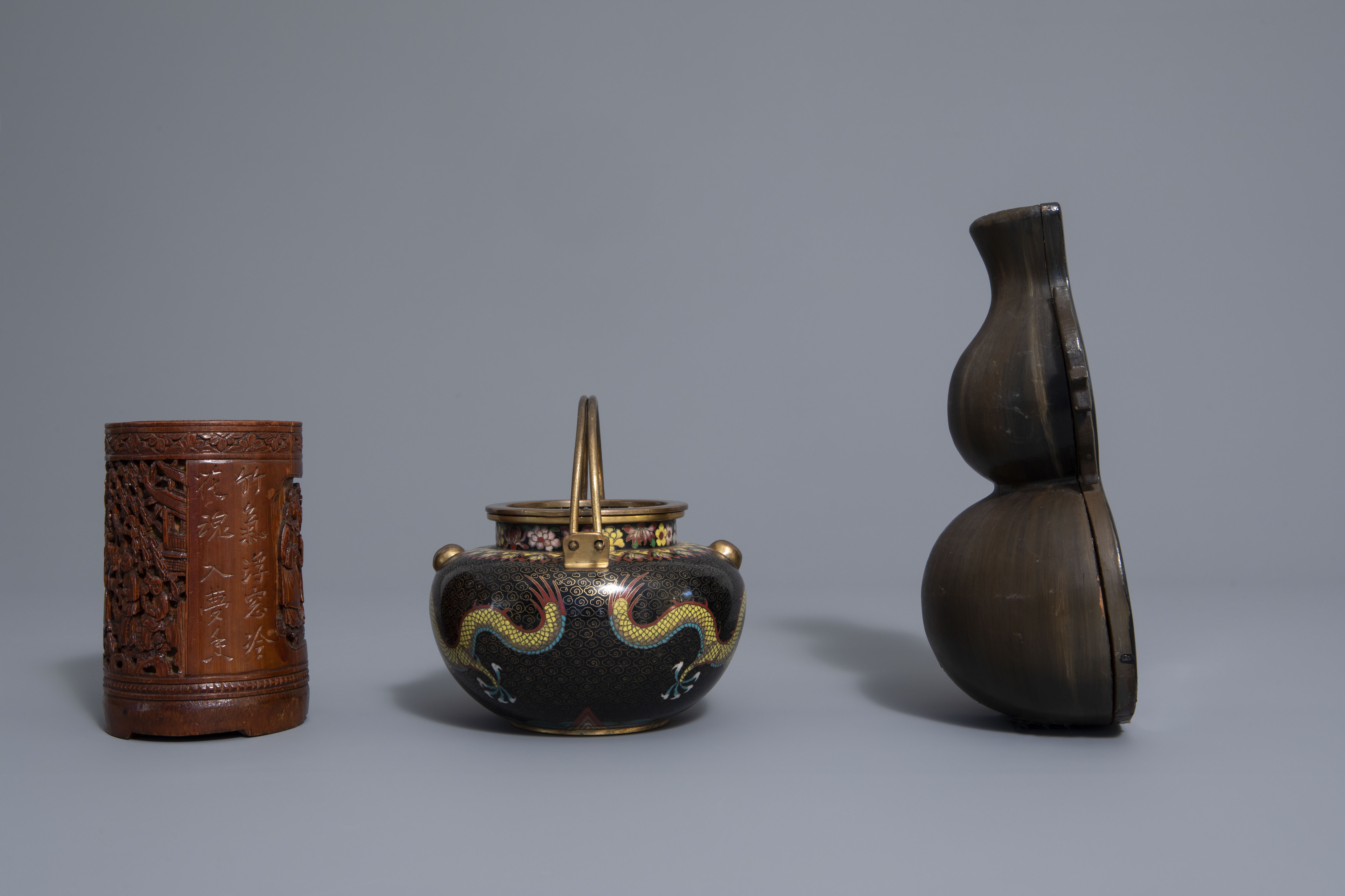 A Chinese tea block, cloisonné teapot, wall vase, bamboo brush pot & 3 red lacquer vases, 20th C. - Image 11 of 16