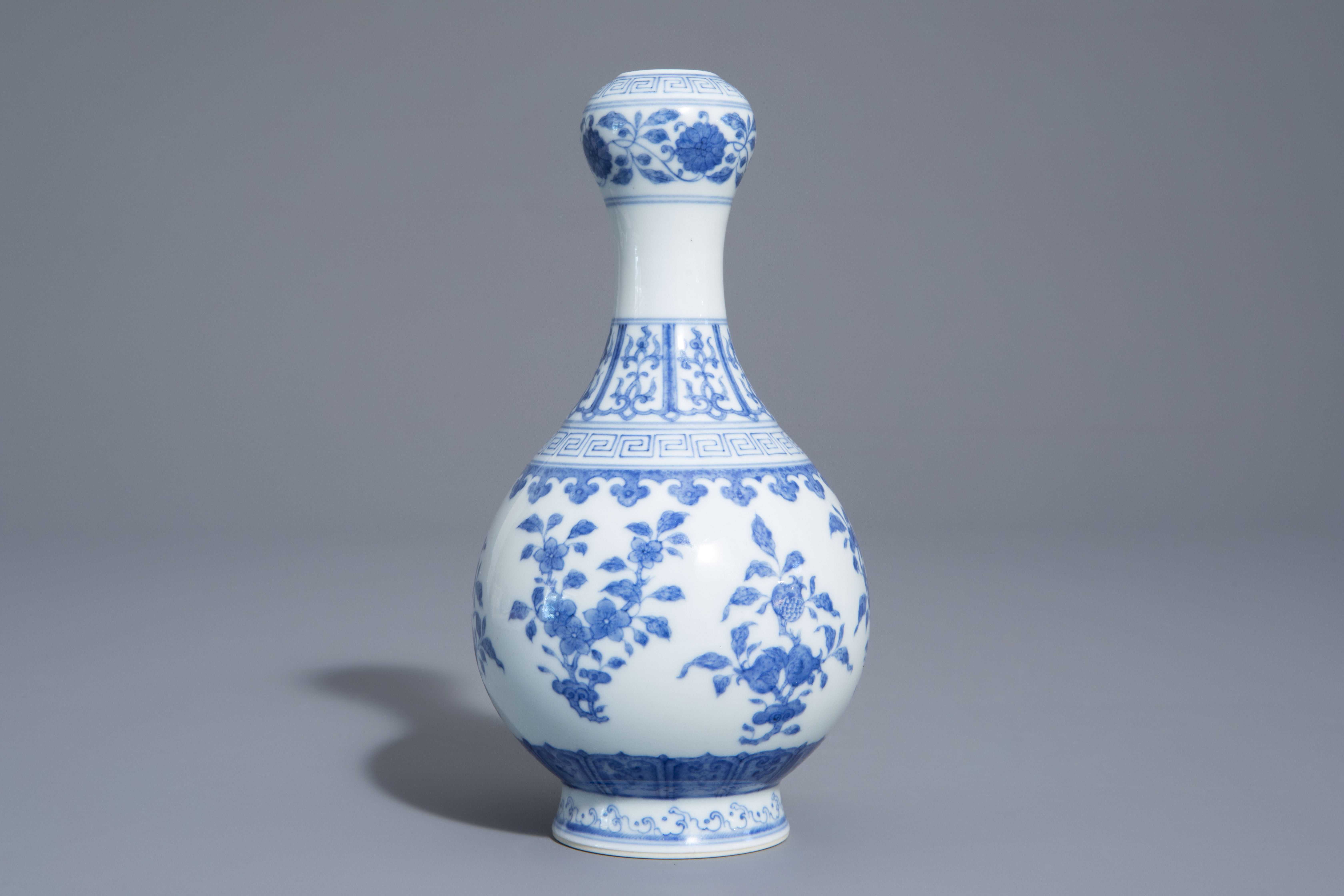 A Chinese blue and white garlic-head mouth vase with floral design, Qianlong mark, 20th C. - Image 3 of 7