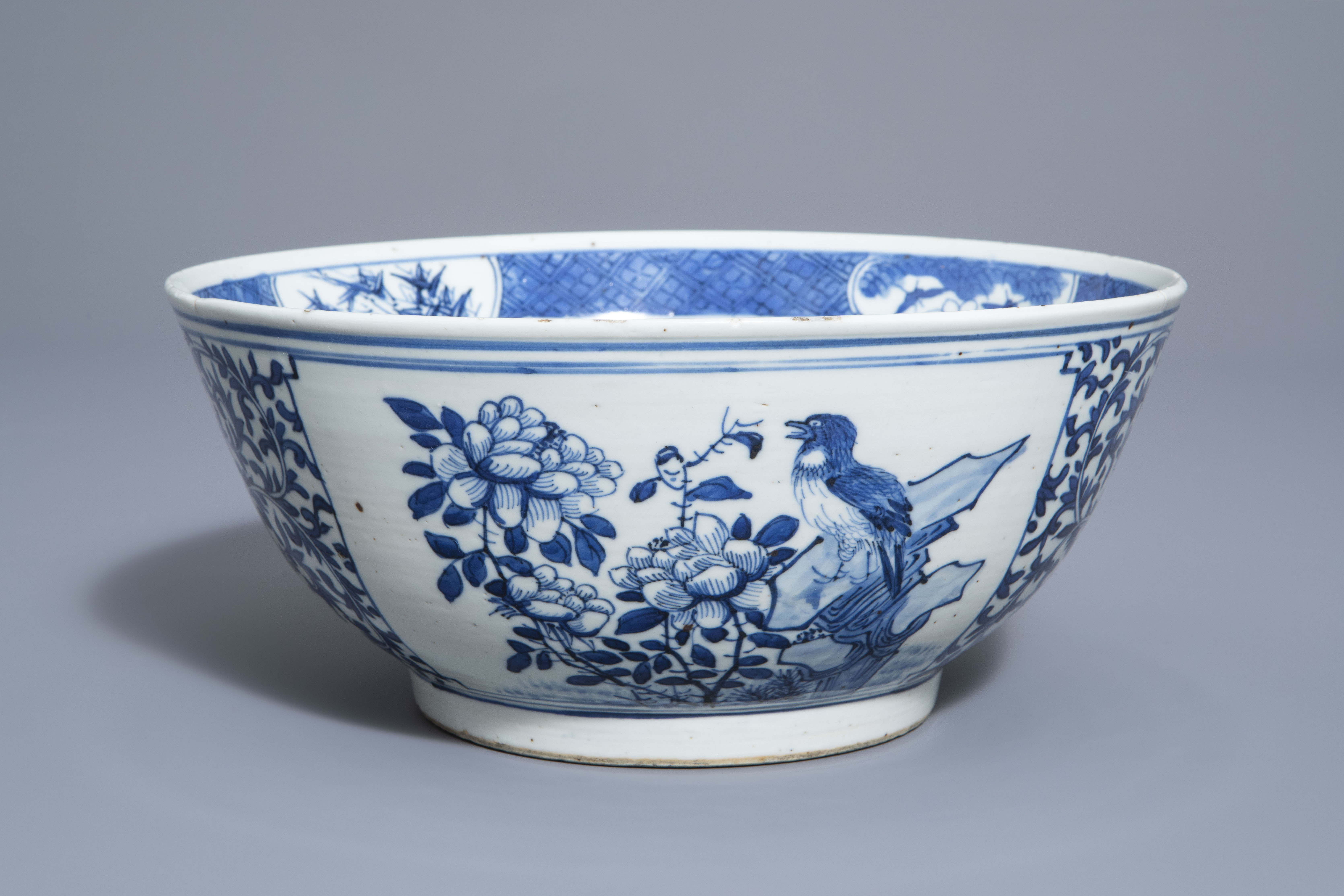 A Chinese blue and white bowl with birds and flowers, 19th C.