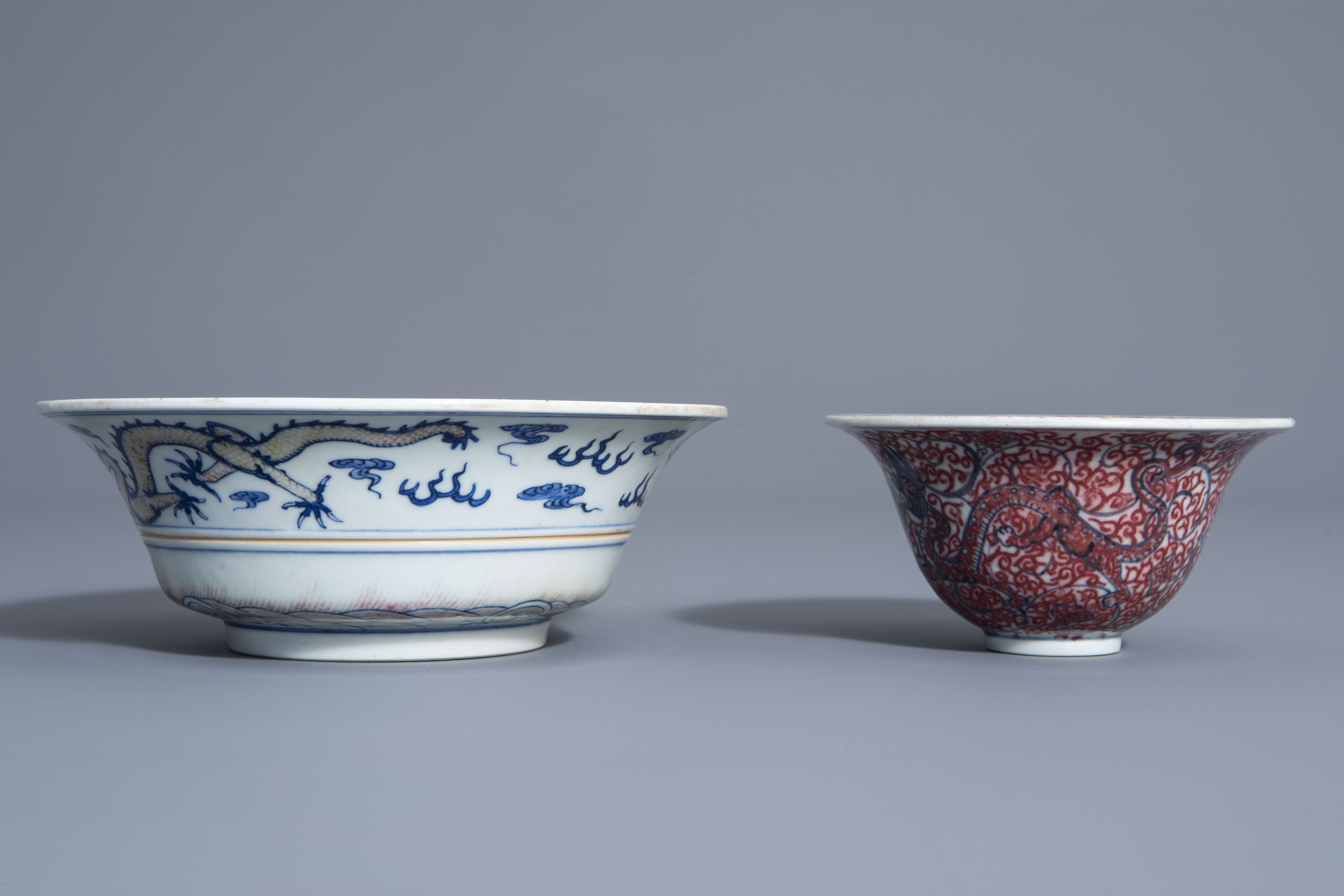 Two Chinese blue, white and copper red bowls, Kangxi mark, 19th/20th C. - Image 5 of 7