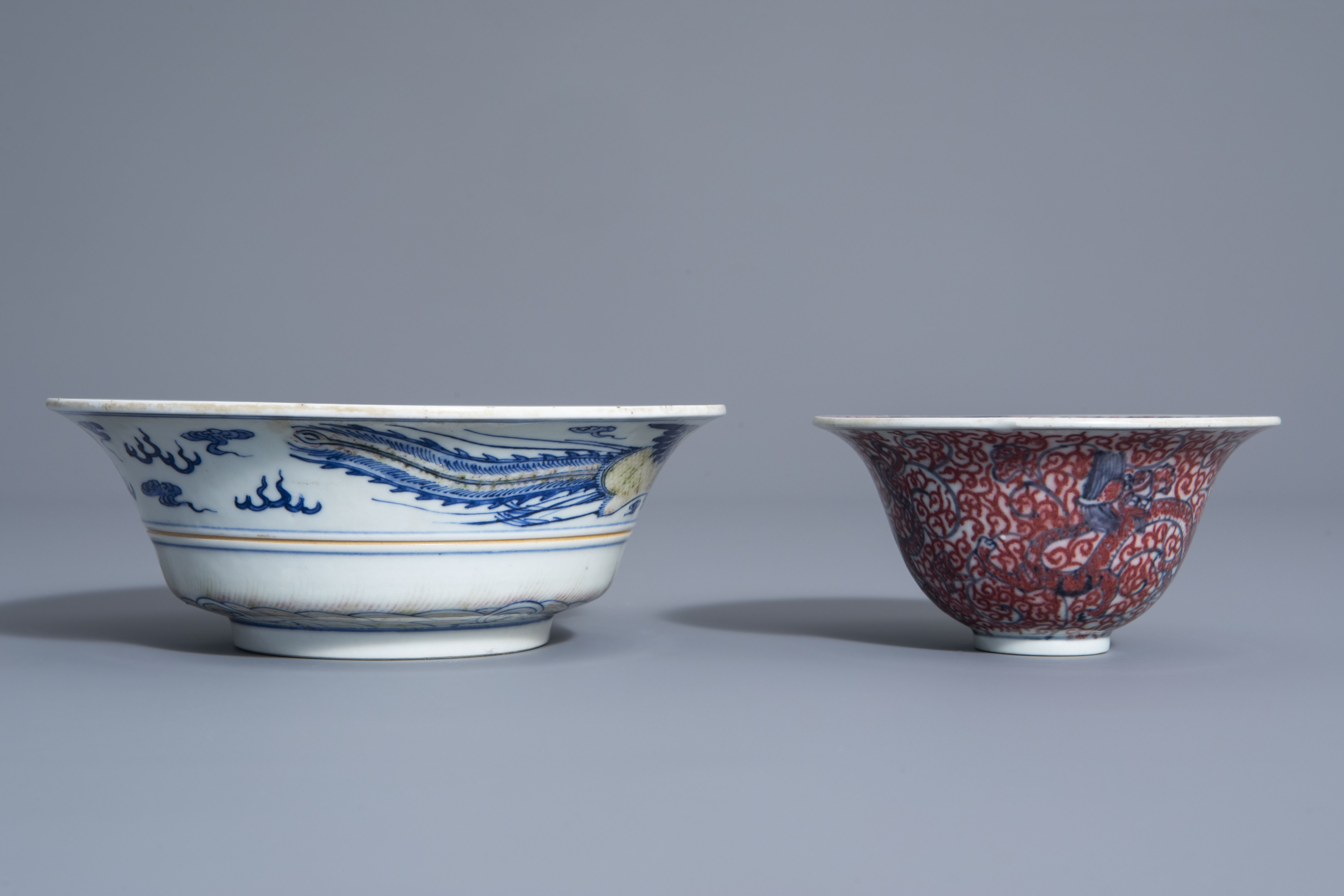 Two Chinese blue, white and copper red bowls, Kangxi mark, 19th/20th C. - Image 4 of 7