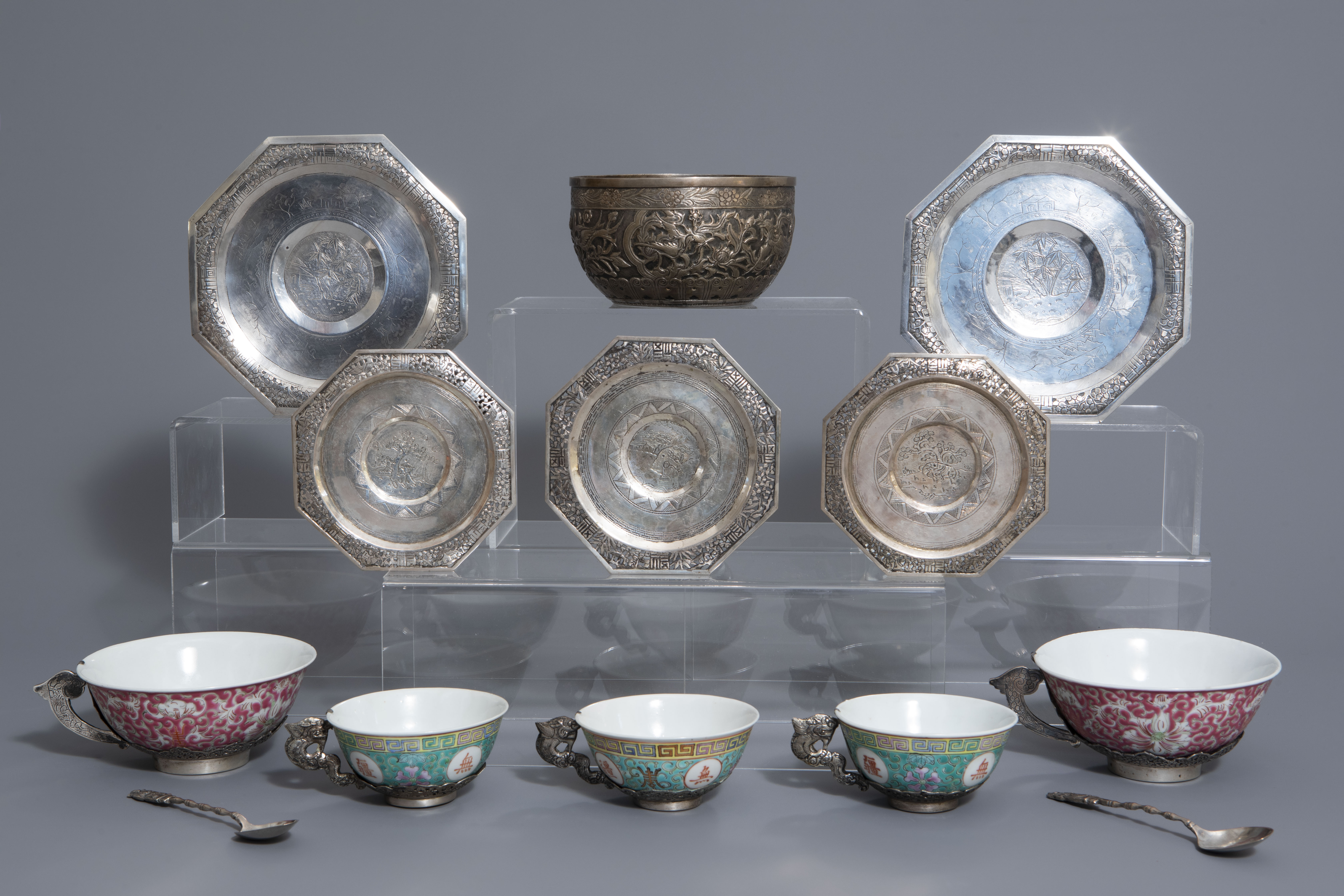 Five Chinese famille rose and silver cups and saucers and a bowl, 19th/20th C.