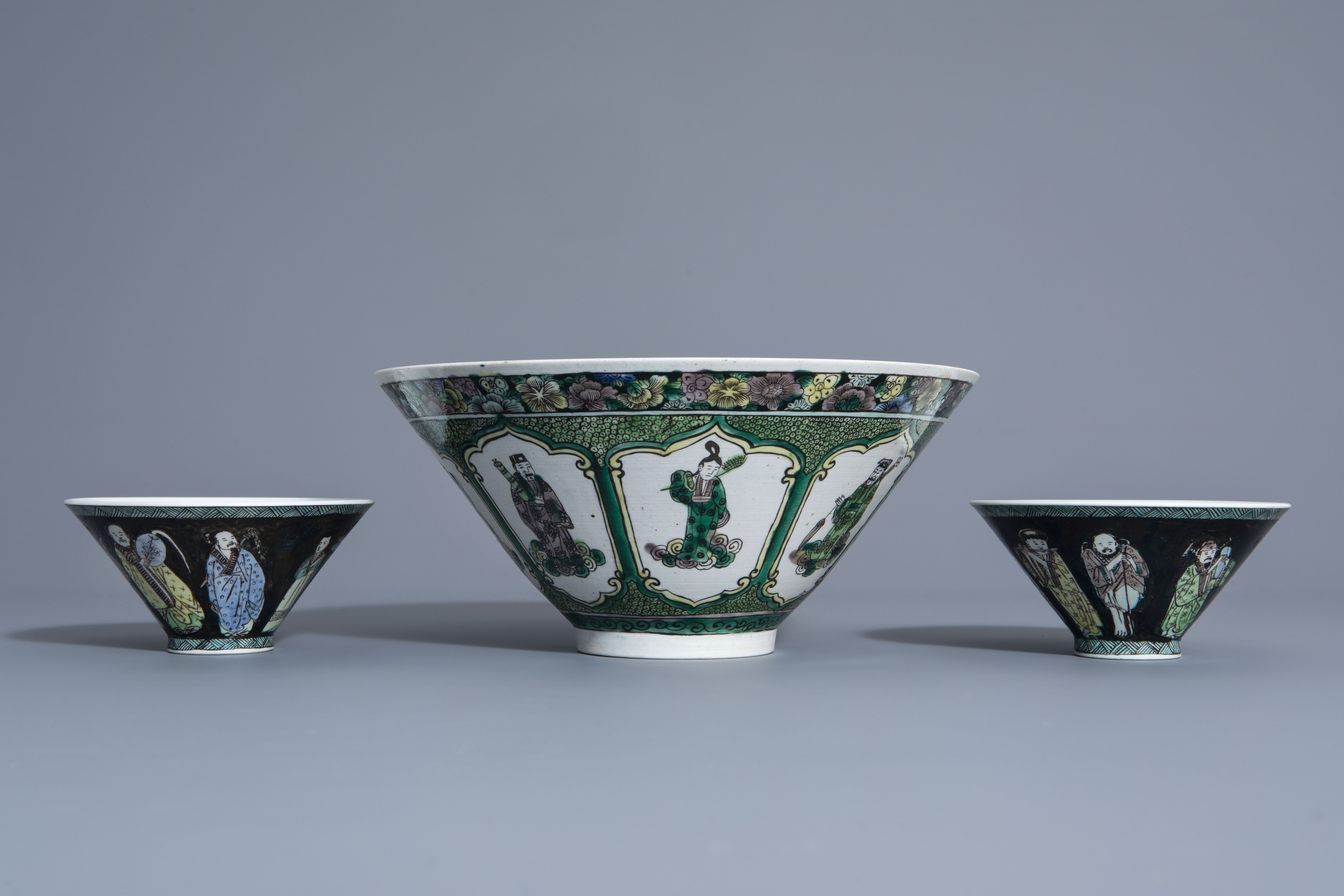Three Chinese verte biscuit bowls with figurative design, Republic, 20th C.