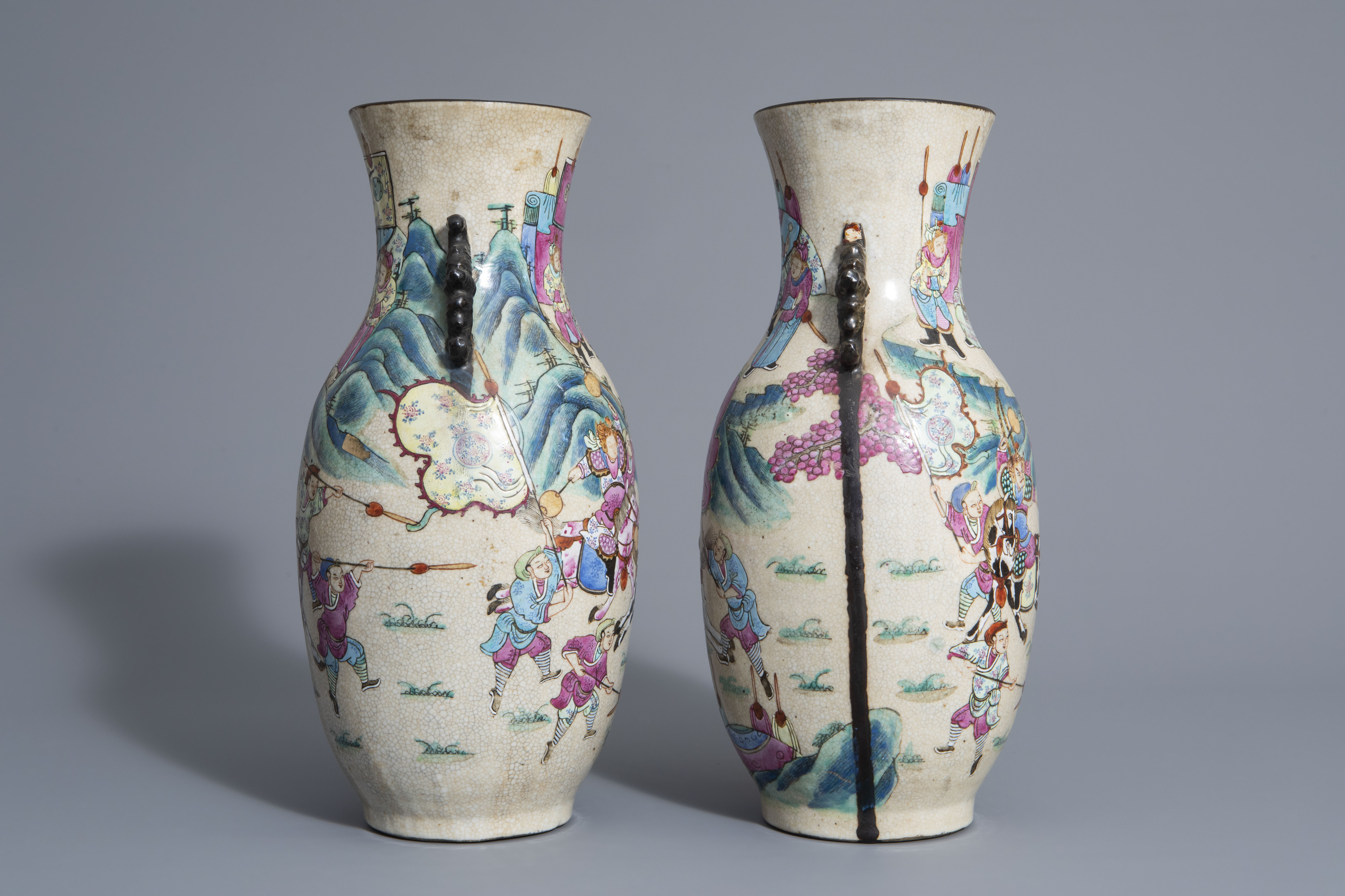 A pair of Chinese Nanking crackle glazed famille rose vases w. warrior scenes on stands, 19th C. - Image 3 of 7