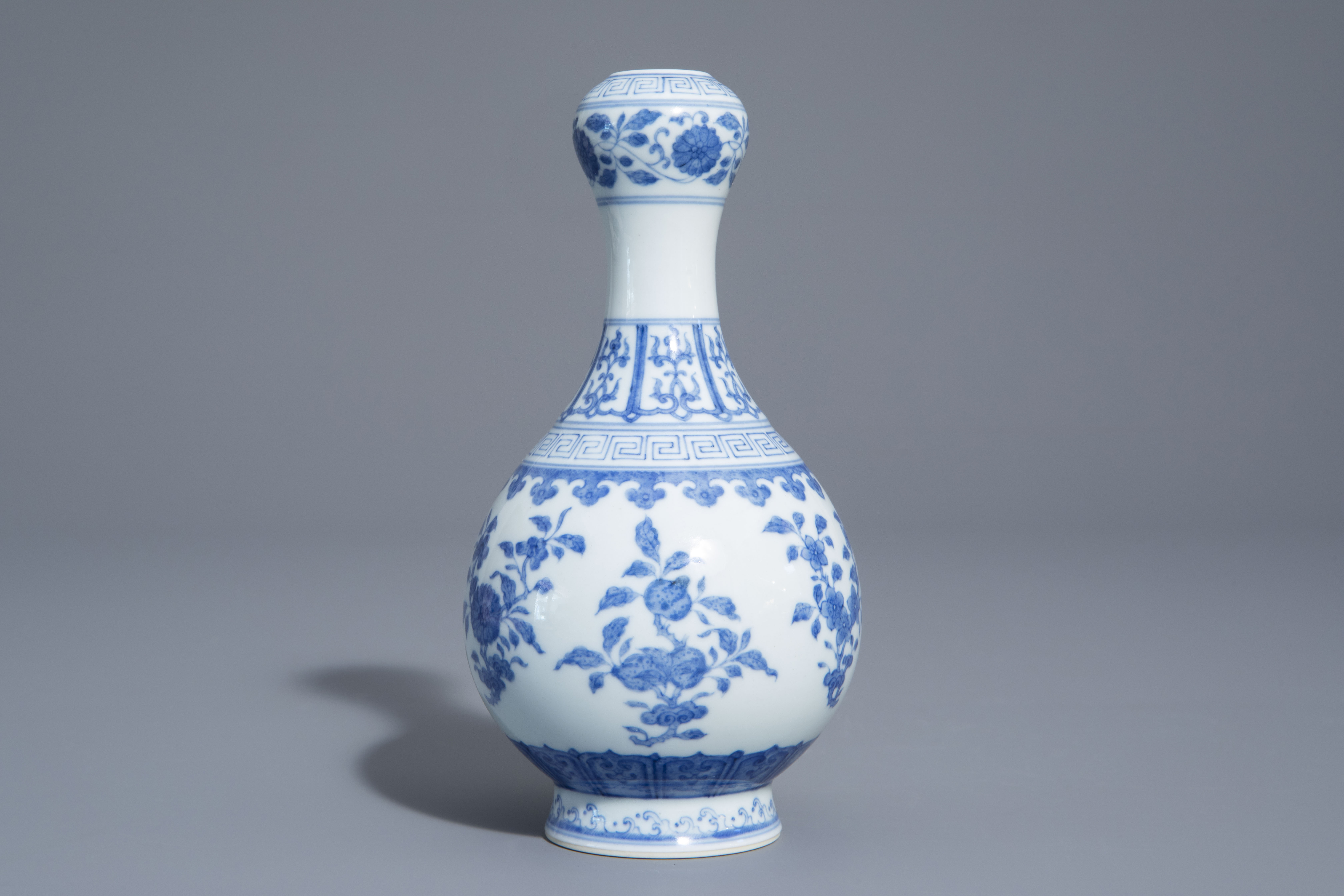 A Chinese blue and white garlic-head mouth vase with floral design, Qianlong mark, 20th C. - Image 4 of 7