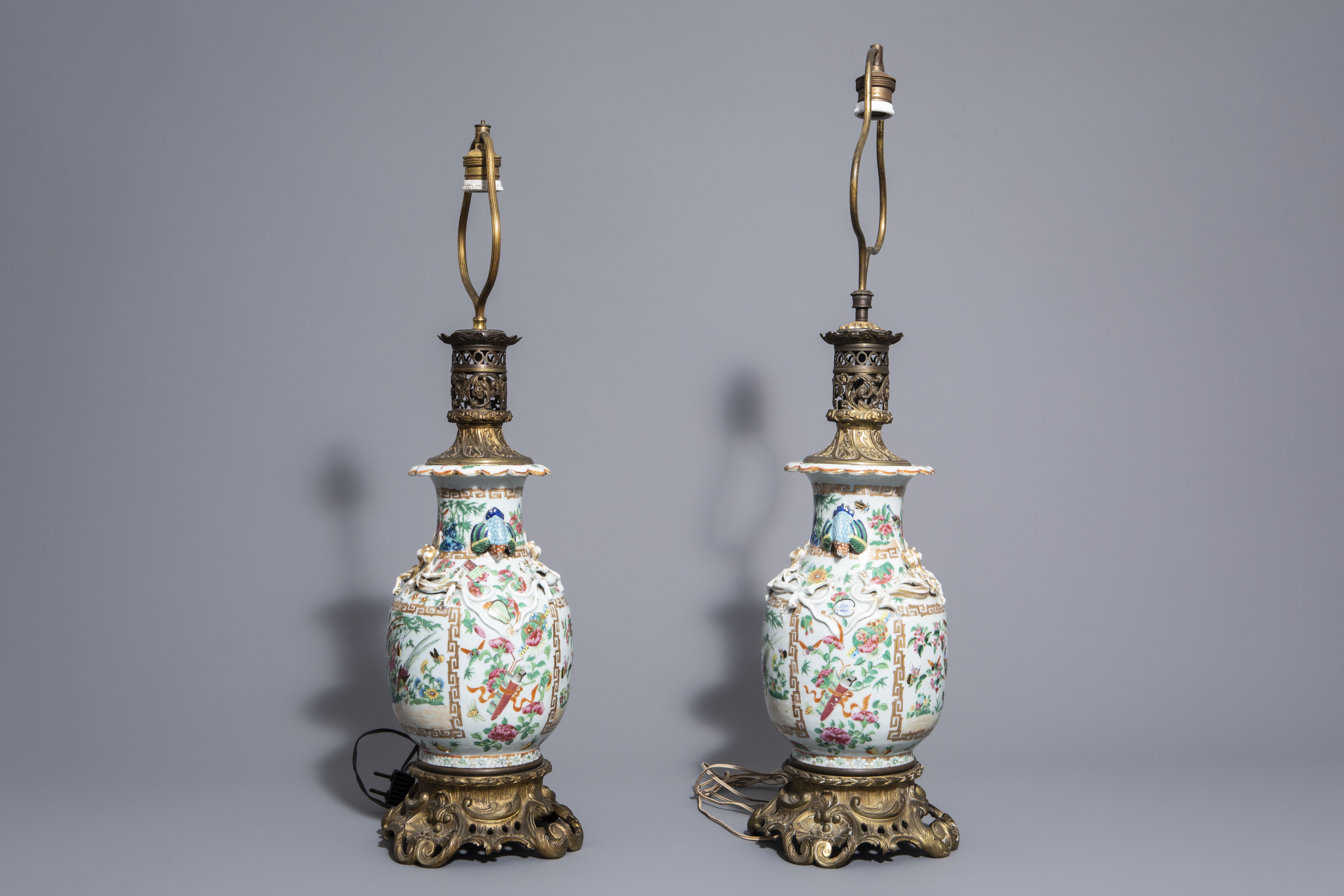 A pair of Chinese Canton famille rose vases mounted as lamps and a famille verte jar, 19th C. - Image 5 of 13