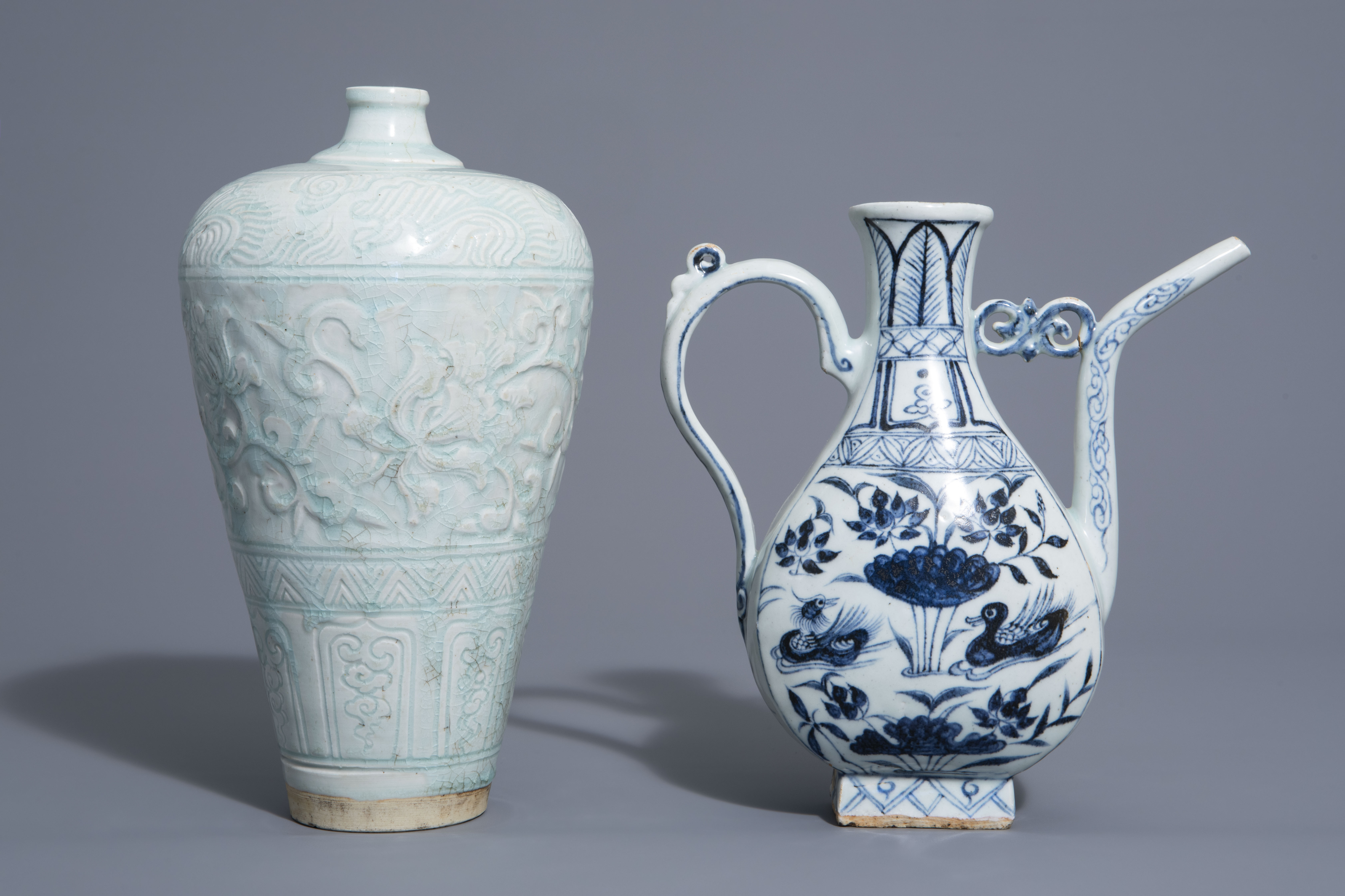 A Chinese blue and white jug and a qingbai vase in Yuan style, 19th/20th C.