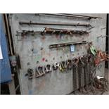 (LOT) LIFTING EQUIPMENT ON WALL, (5) SWIVEL EYES, (4) SHACKLES, (2) CHAINS & MISC.