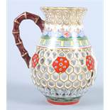 A Chamberlain's Worcester double walled reticulated baluster shaped jug with faux bamboo handle, 4