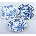 """A Delft square dish, decorated cows and castle, 8"""" square, and a pair of Delft plates, decorated"""
