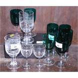 An assortment of early 20th century green wine glasses and other glassware
