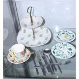 """A Midwinter """"Capri"""" cake stand, two Midwinter """"Moonflare"""" green floral saucers, designed by Jessie"""