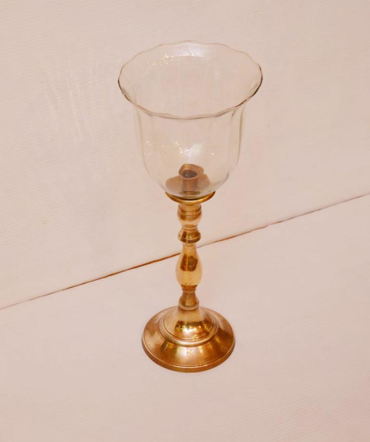 Lot 232 - A Brass Based Candle Holder
