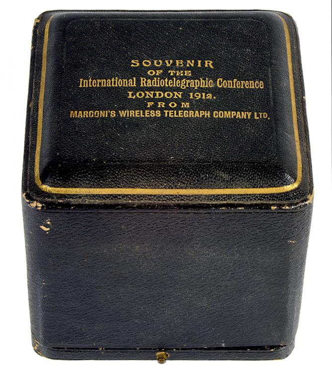 Lot 942 - TELEGRAPHY. A RARE MINIATURE SILVER AND FERROUS METAL LIGHTER AS A MODEL OF MARCONI'S DISC