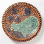 ALOIS JARONÌK 1870 - 1944: A PLATE WITH A ROOSTER MOTIF 1908 Glazed ceramic ?57.5 cm Signed on