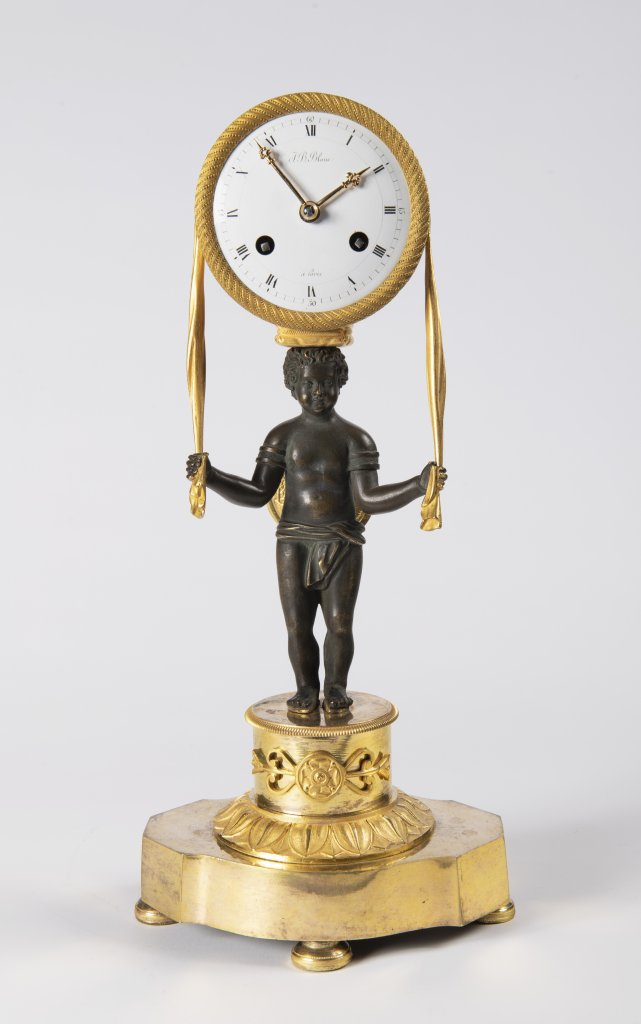 AN EMPIRE TABLE CLOCK Ca. 1810 France Paøíž Gilt bronze, enamel 37 x 17 x 10 cm This elegant,