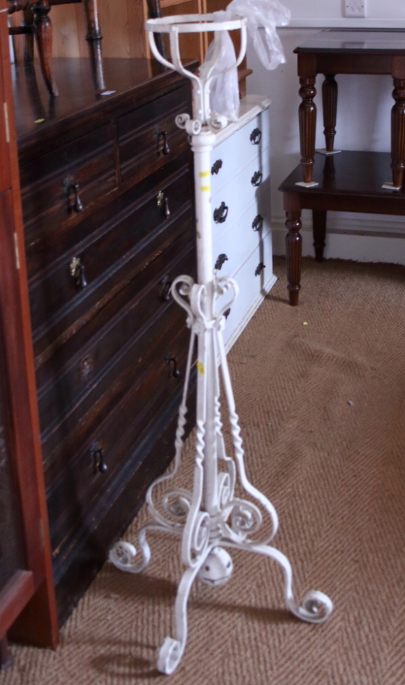 Lot 432 - A Victorian white painted adjustable lamp / stand, on splay supports