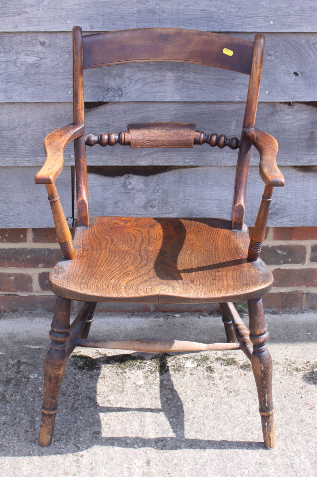 Lot 409 - A 19th century Oxford bar back elbow chair with panel seat