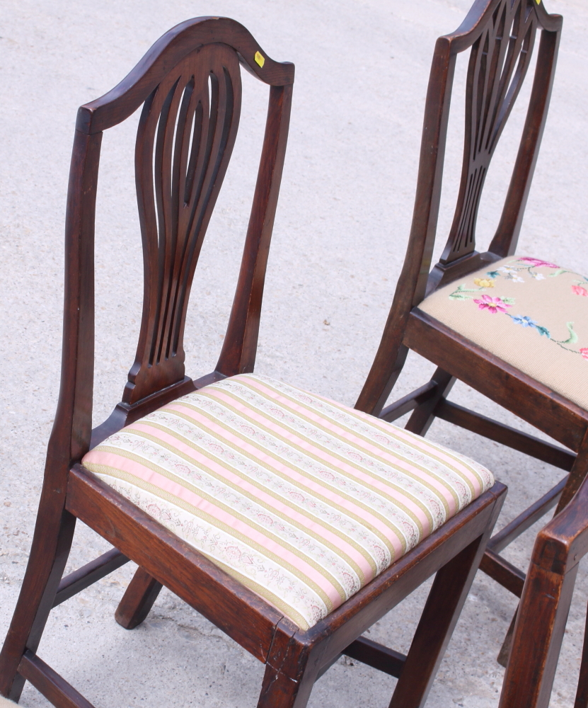 Lot 436 - A matched set of eight oak splat back chairs with drop-in seats, on square tapering supports
