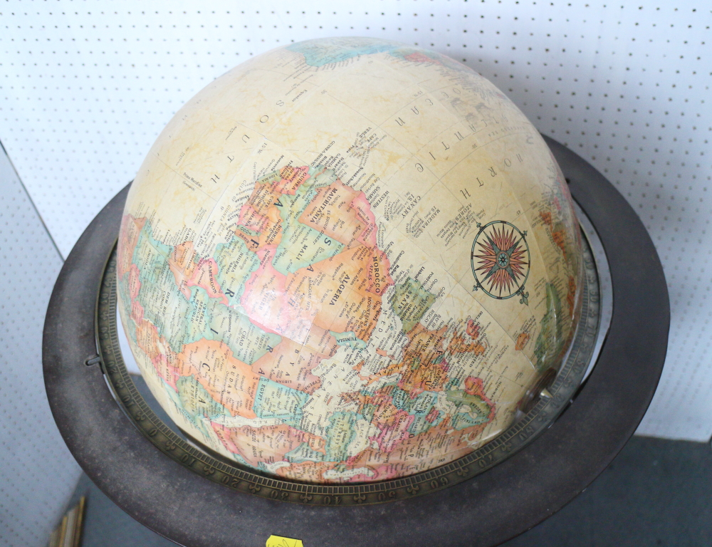 Lot 142 - A terrestrial globe, on wrought iron stand with three splayed supports