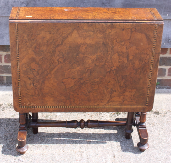 Lot 407 - A 19th century figured walnut and banded Sutherland tea table, on twin turned columns and splay