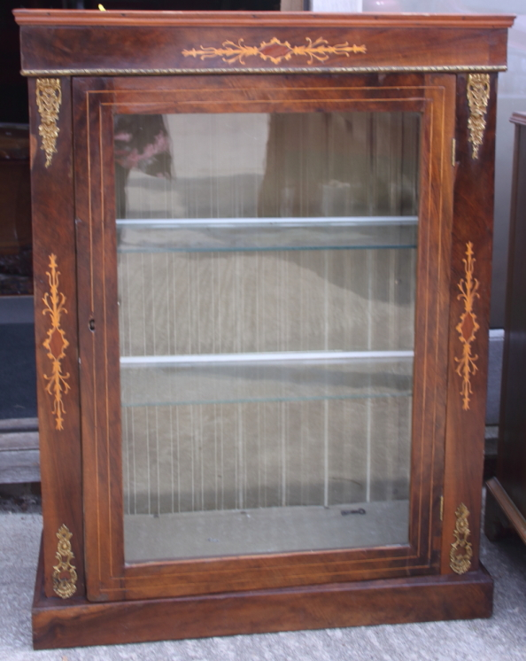 """Lot 394 - A late 19th century figured walnut and inlaid pier cabinet with gilt brass mounts, 28"""" wide"""