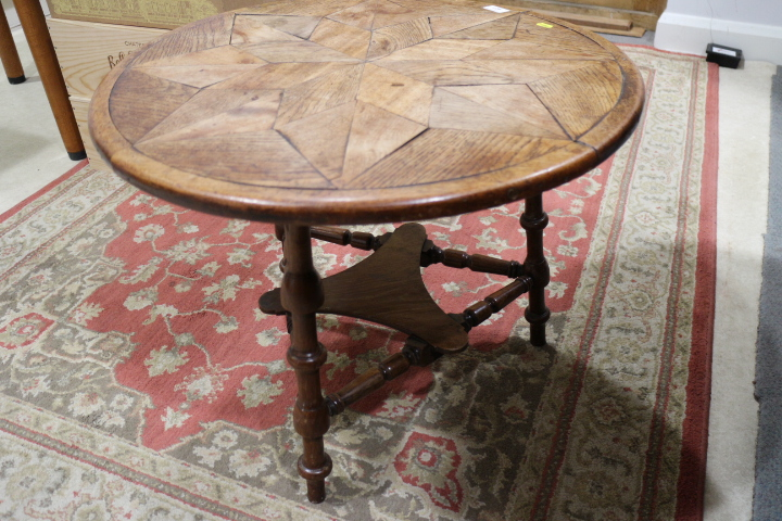 """Lot 423 - A 19th century oak parquetry topped two-tier cricket table, 25"""" dia x 20"""" high"""
