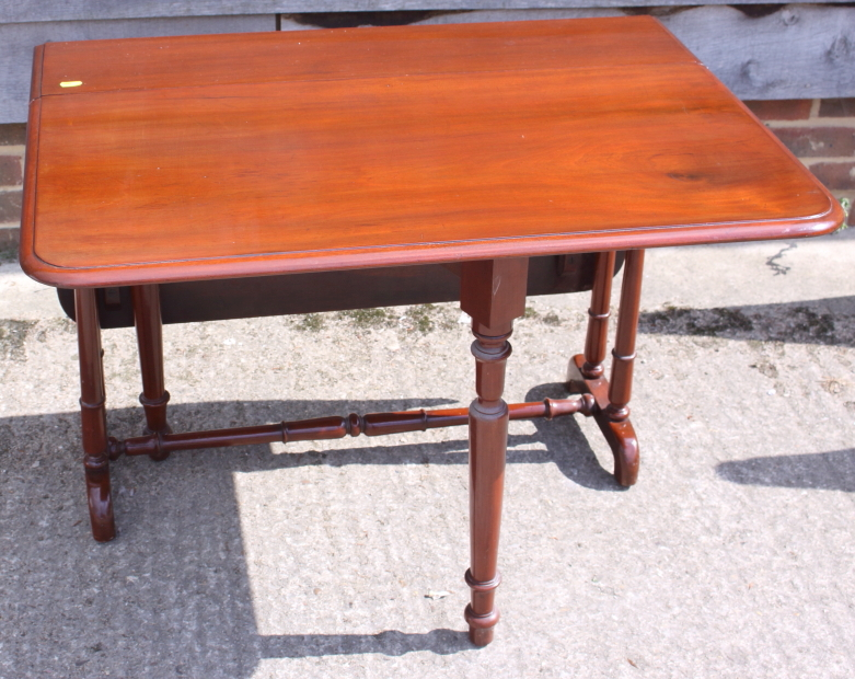Lot 408 - A late 19th century mahogany Sutherland tea table, on twin turned spindle ends and splay supports,