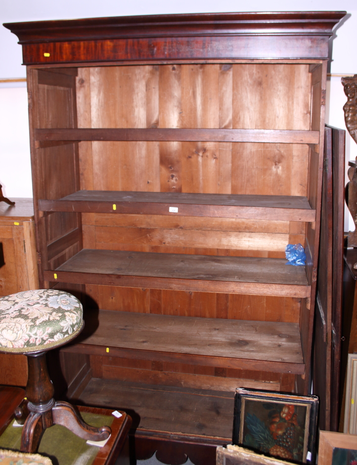 Lot 434 - A Victorian mahogany wardrobe, the interior fitted trays enclosed two Gothic panel doors, on