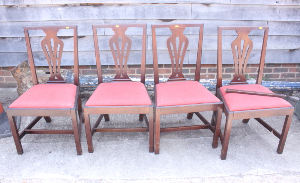 Lot 427 - Four splat back dining chairs with drop-in seats, upholstered in a red fabric, on square chamfered
