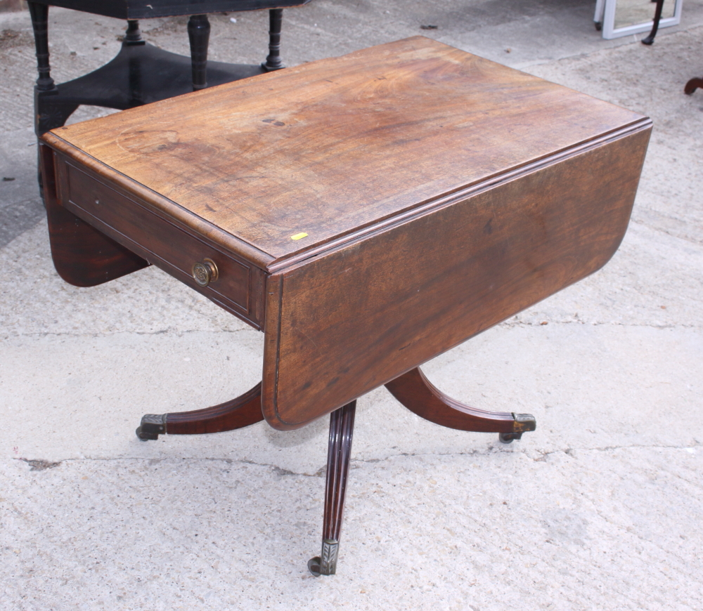 Lot 405 - An early 19th century mahogany Pembroke table, fitted one drawer, on turned column and quadruple