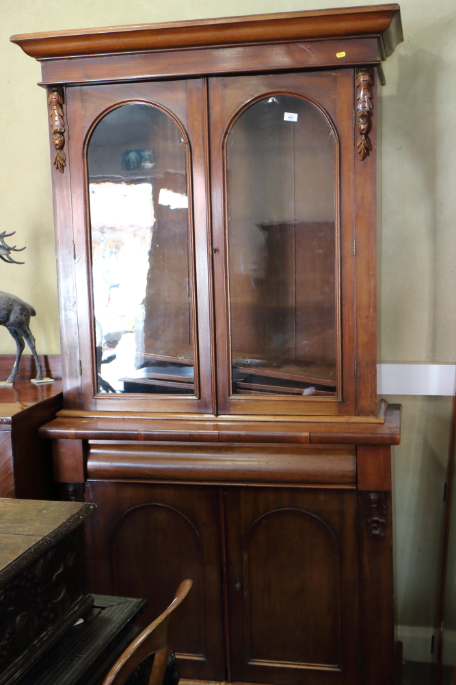Lot 418 - A 19th century walnut bookcase, the upper section enclosed two arched panel doors over one drawer