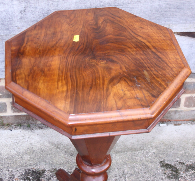 Lot 395 - A Victorian walnut octagonal top work table, fitted central well, on tripod splay supports, 16""